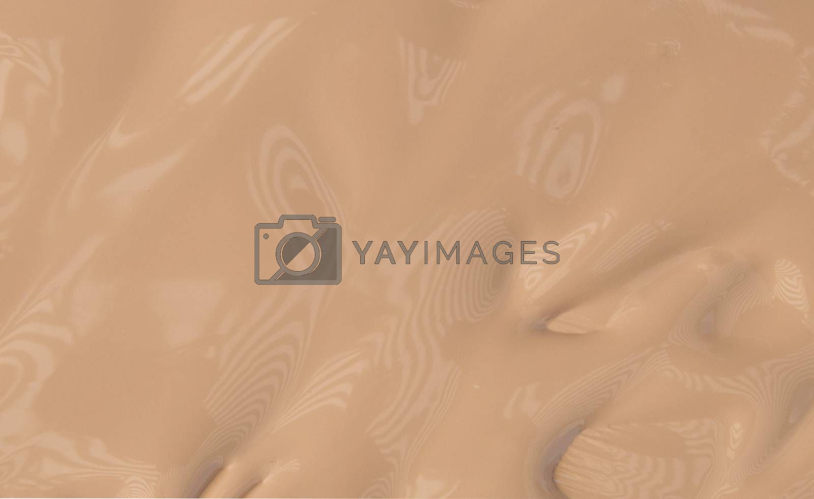 Smeared liquid Foundation isolated on a white background, make-up concept.