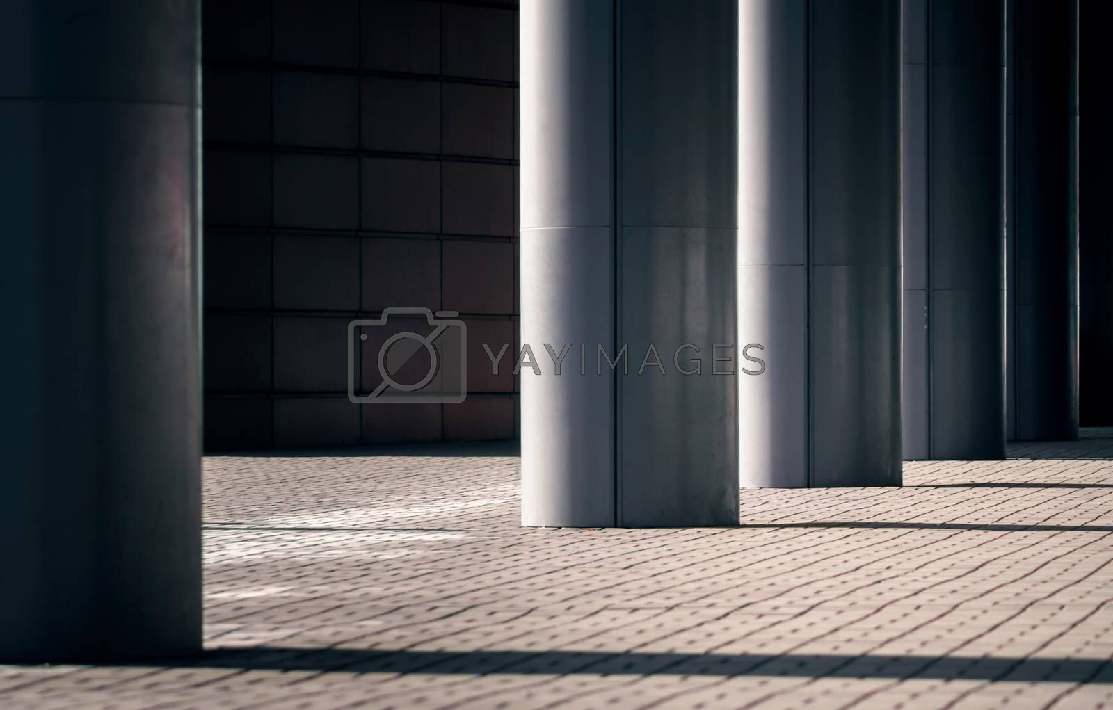 columns of a modern building on a city street without people architectural background
