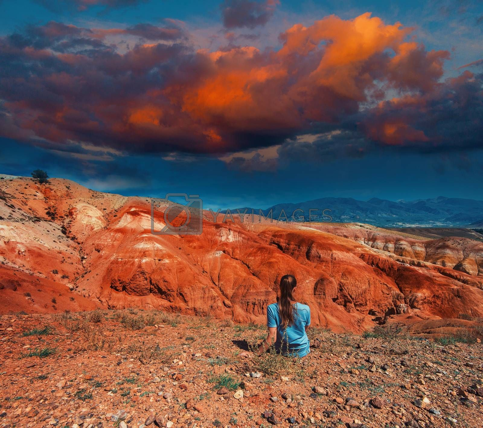 Woman in valley of Mars landscapes in the Altai Mountains, concept of vacation at home, local tourism or domestic tourism