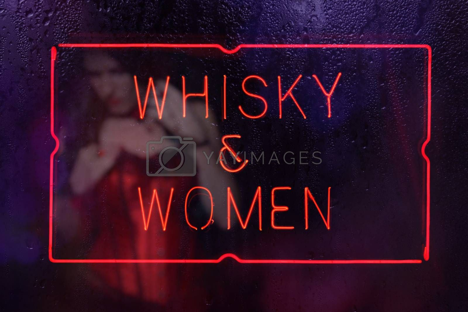 Vintage Neon Whisky and Women Sign in Rainy Window