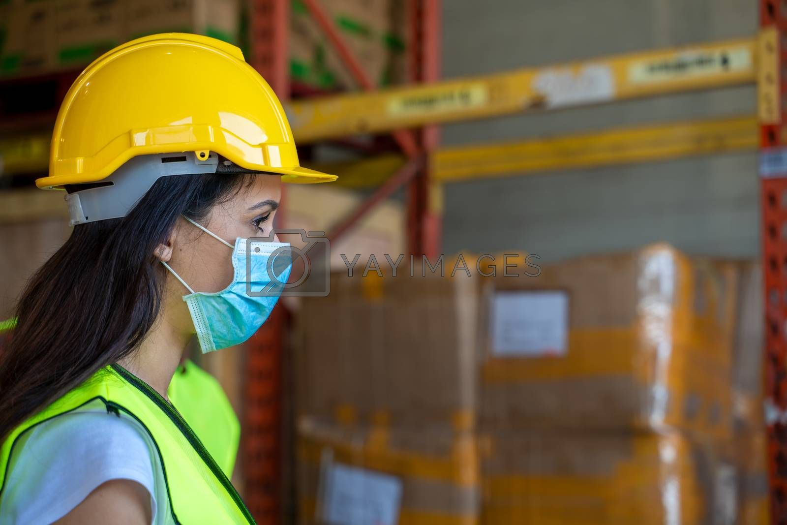 Workers wearing protective mask to Protect Against Covid-19 in warehouse.