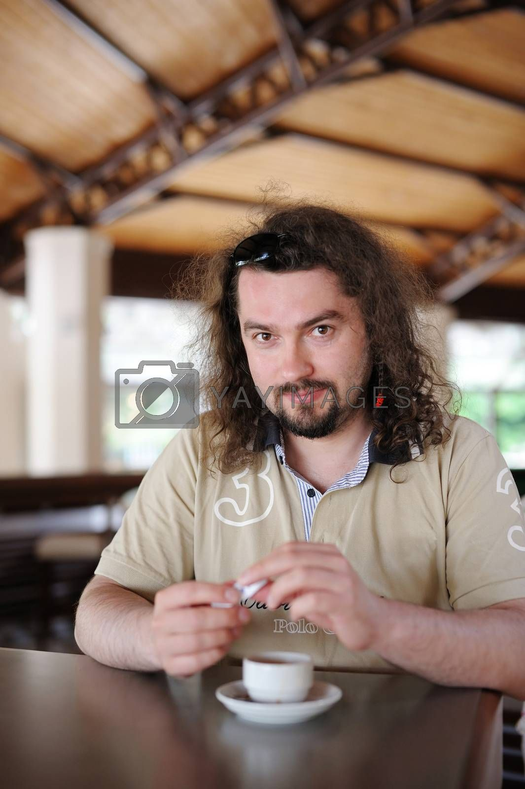Young man having coffee at a resort