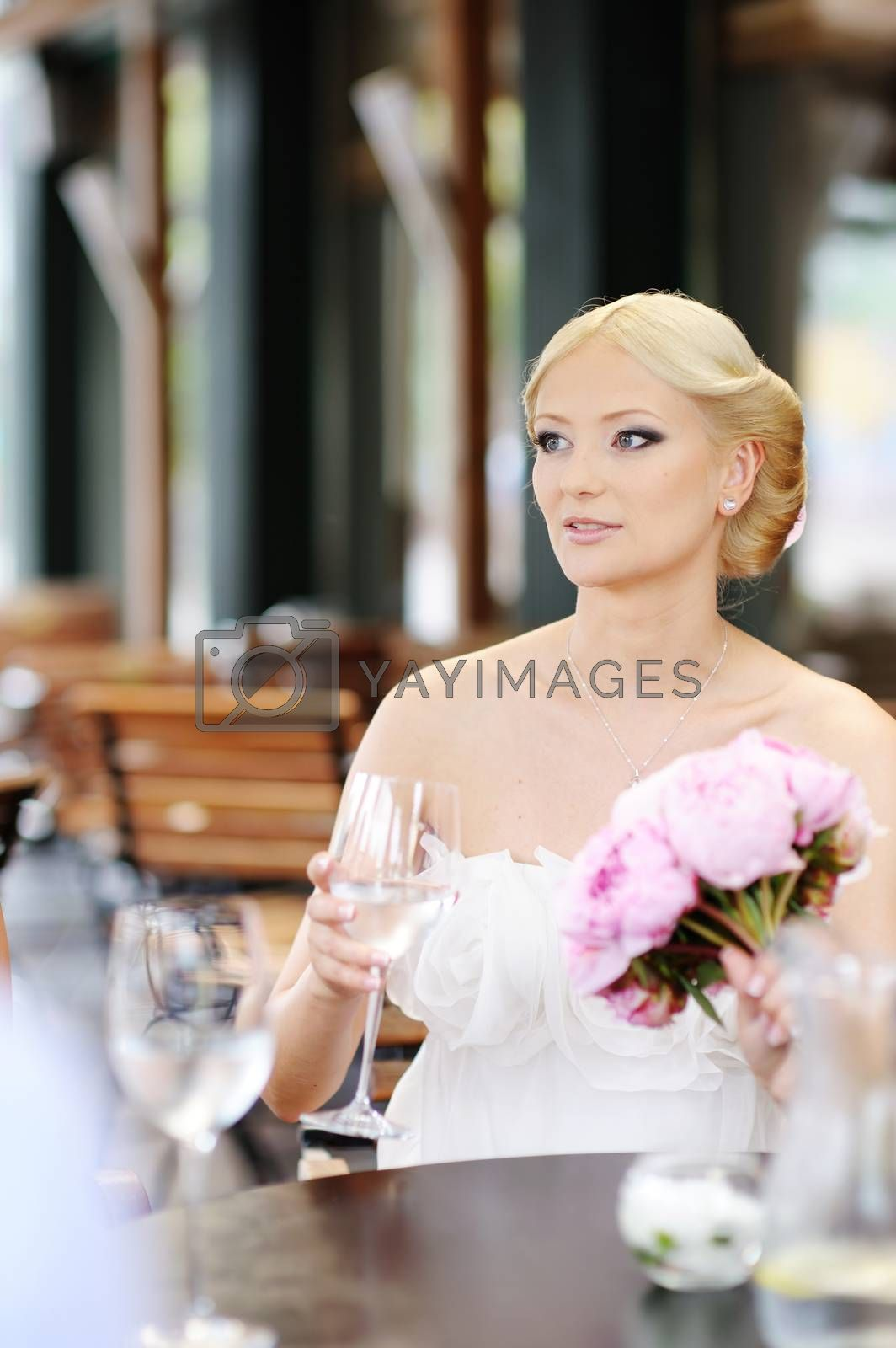 Bride drinking champagne at her wedding