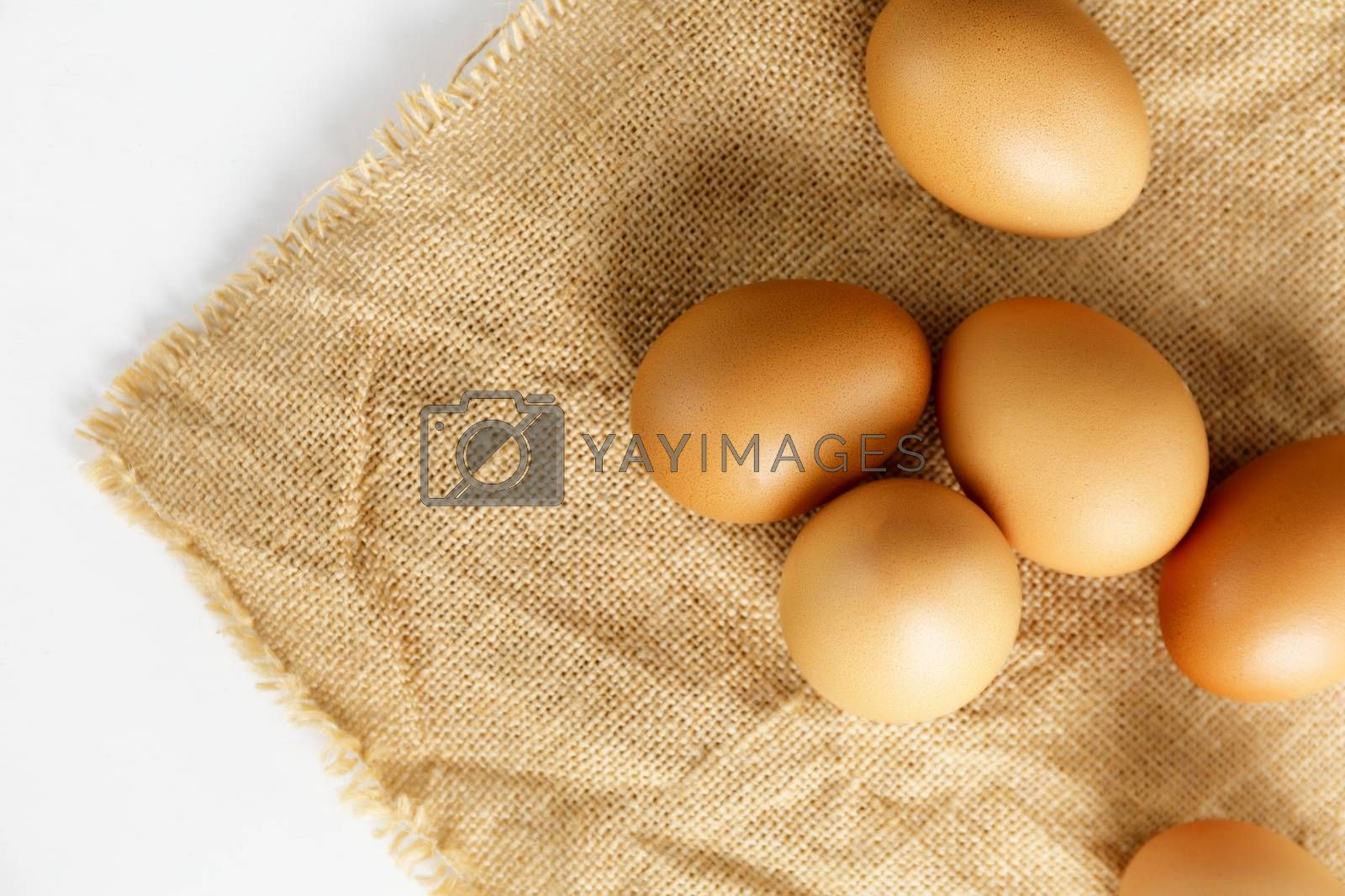 Close up Top view fresh chicken eggs on linen tablecloth with copy space.