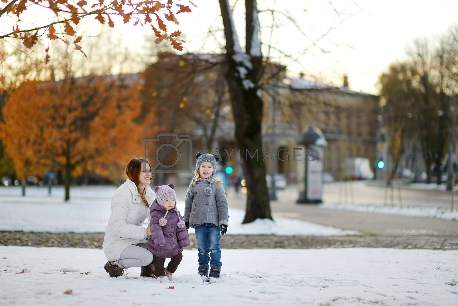Young mother and two kids having fun on winter day