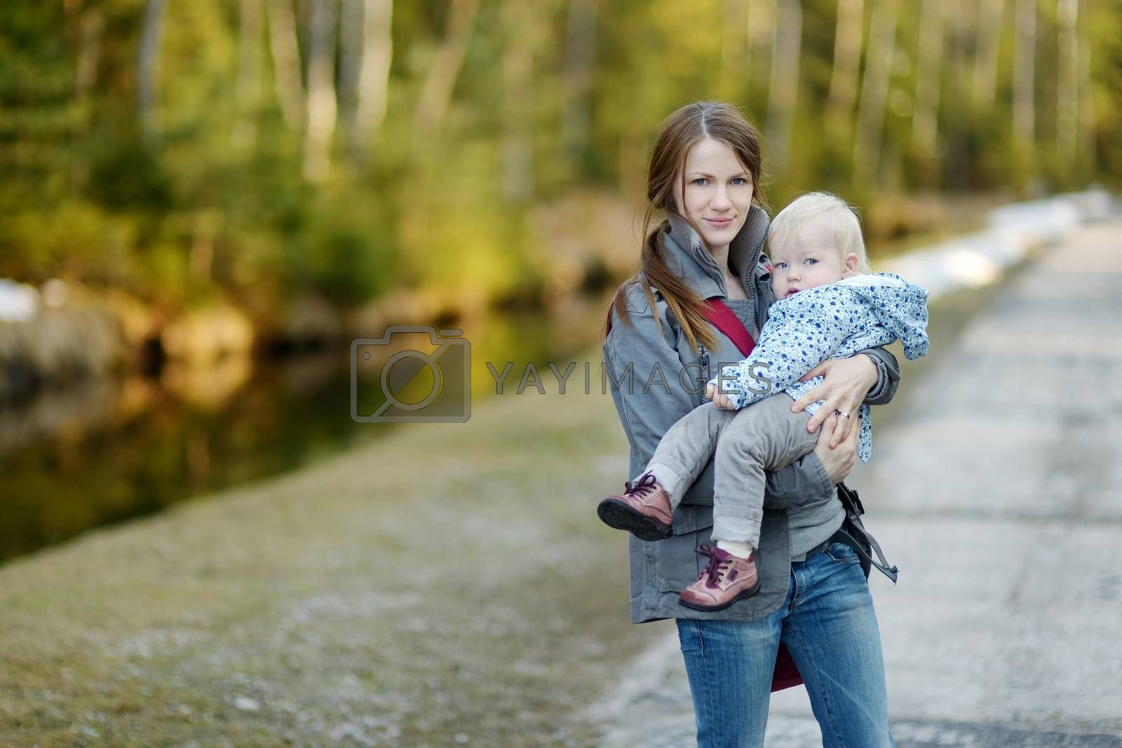 Adorable toddler girl in mothers hands