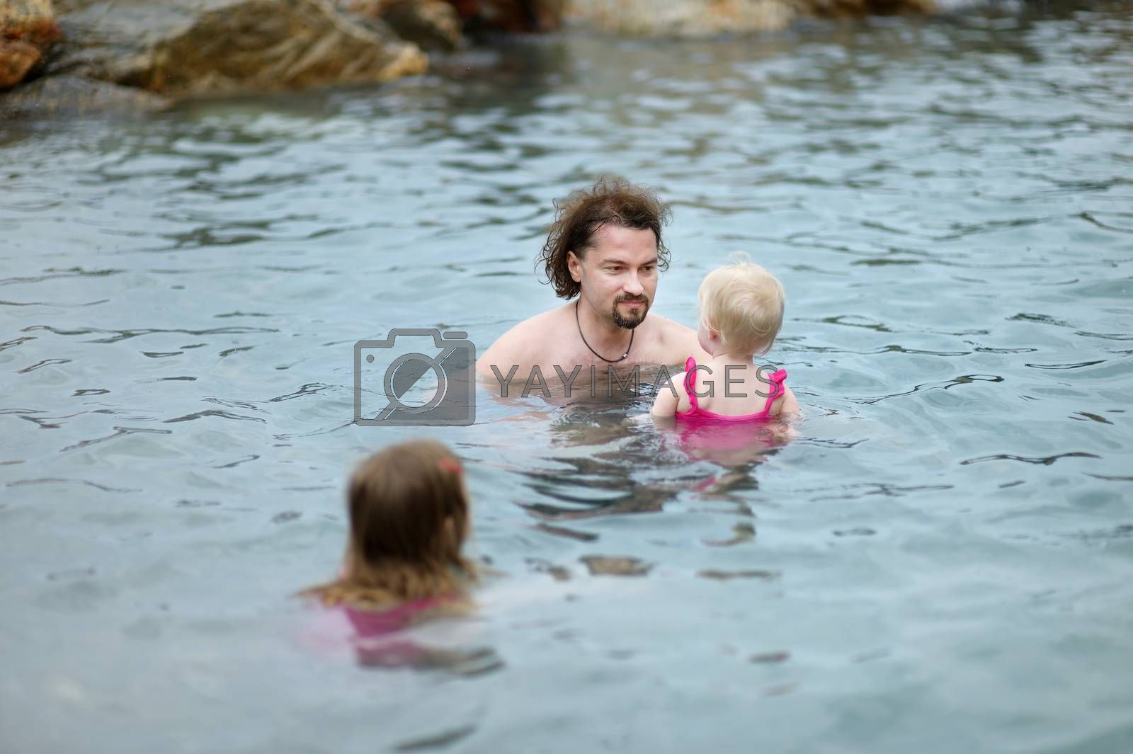 Father and his kids relaxing in hot spring on Kos island