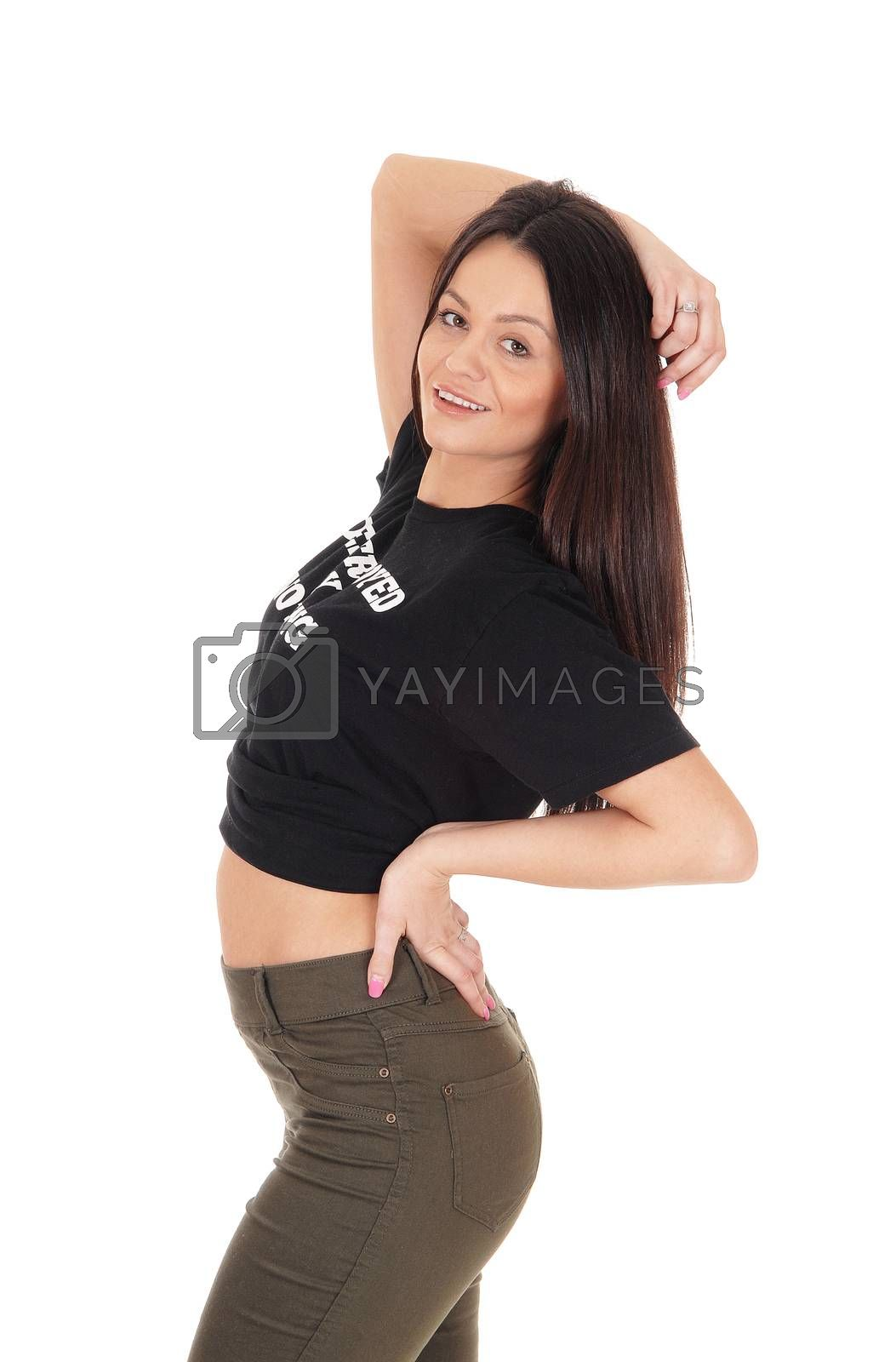 Beautiful slim young woman standing in the studio in profile bending backwards, isolated for white background