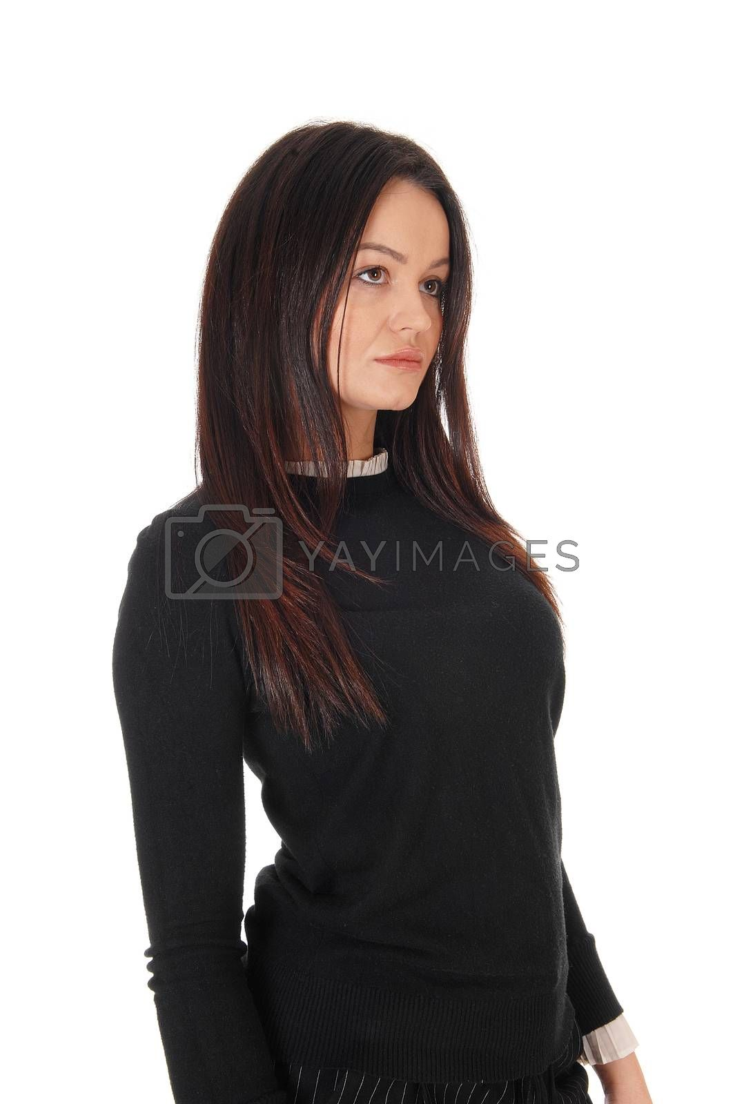 A gorgeous young woman standing in profile in a back sweater, looking away and sad, isolated for white background