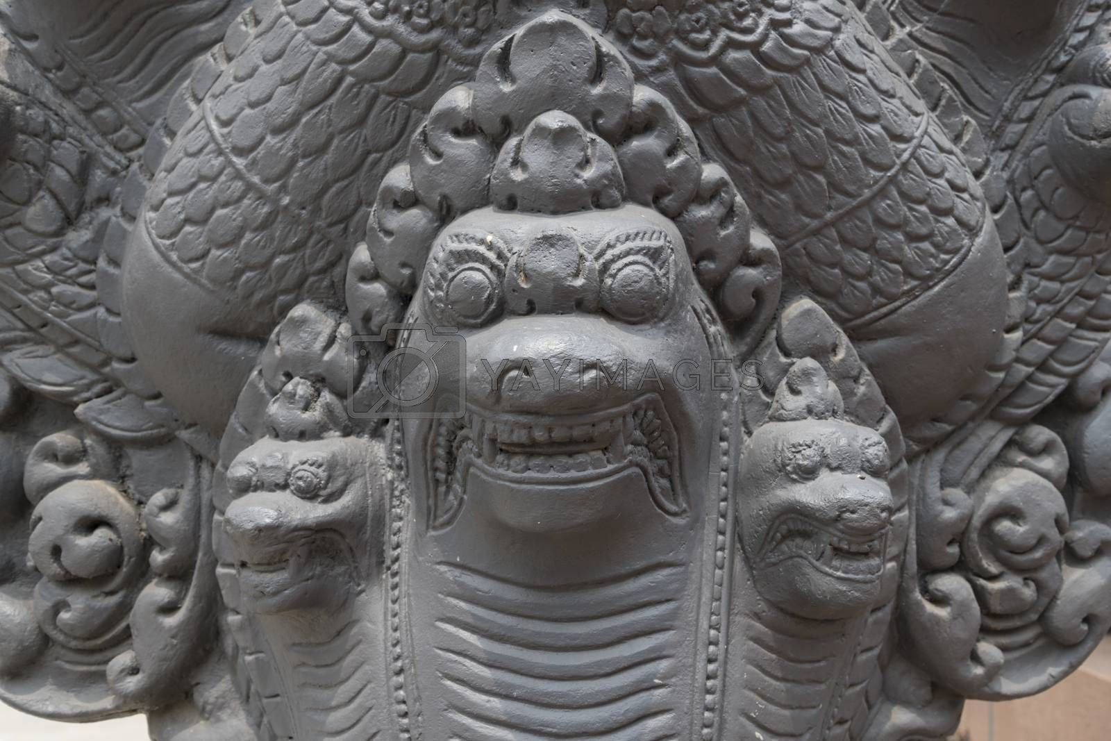 Details of a Mythical Seven-Headed Snake goddess, Khmer Naga sculpture, Buddhist temple Wat Preah Prom Rath in Siem Reap, Cambodia, Asia