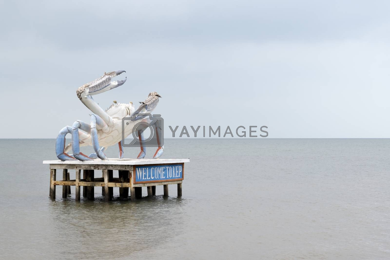 Oversized statue of a crab rising from the sea just offshore welcoming people to Kep and showing what is famous there. Kep, Cambodia