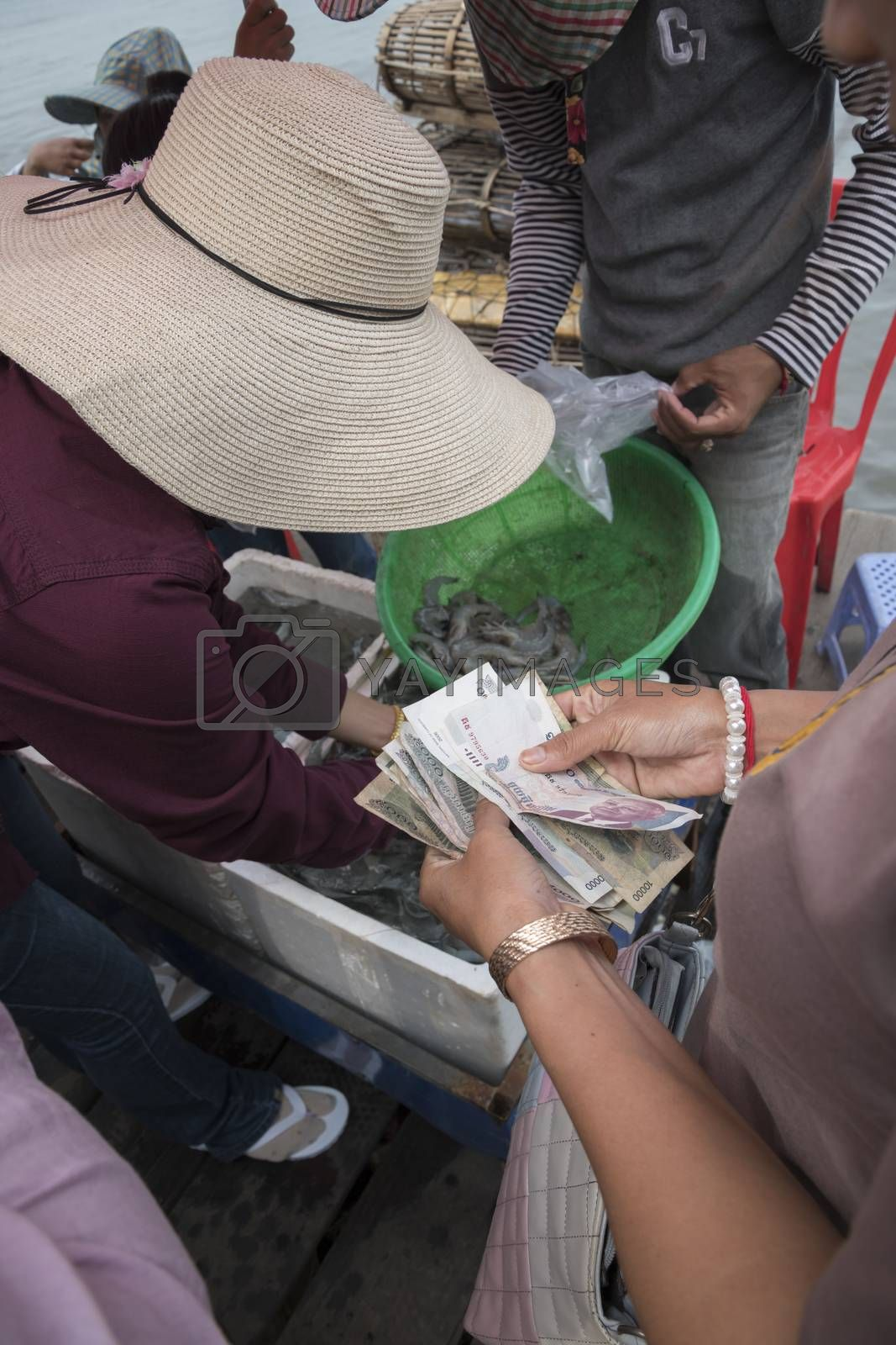 Krong Kaeb, Kep Province, Cambodia, 31 March 2018. Woman buying fresh and live crabsat the Crab Market