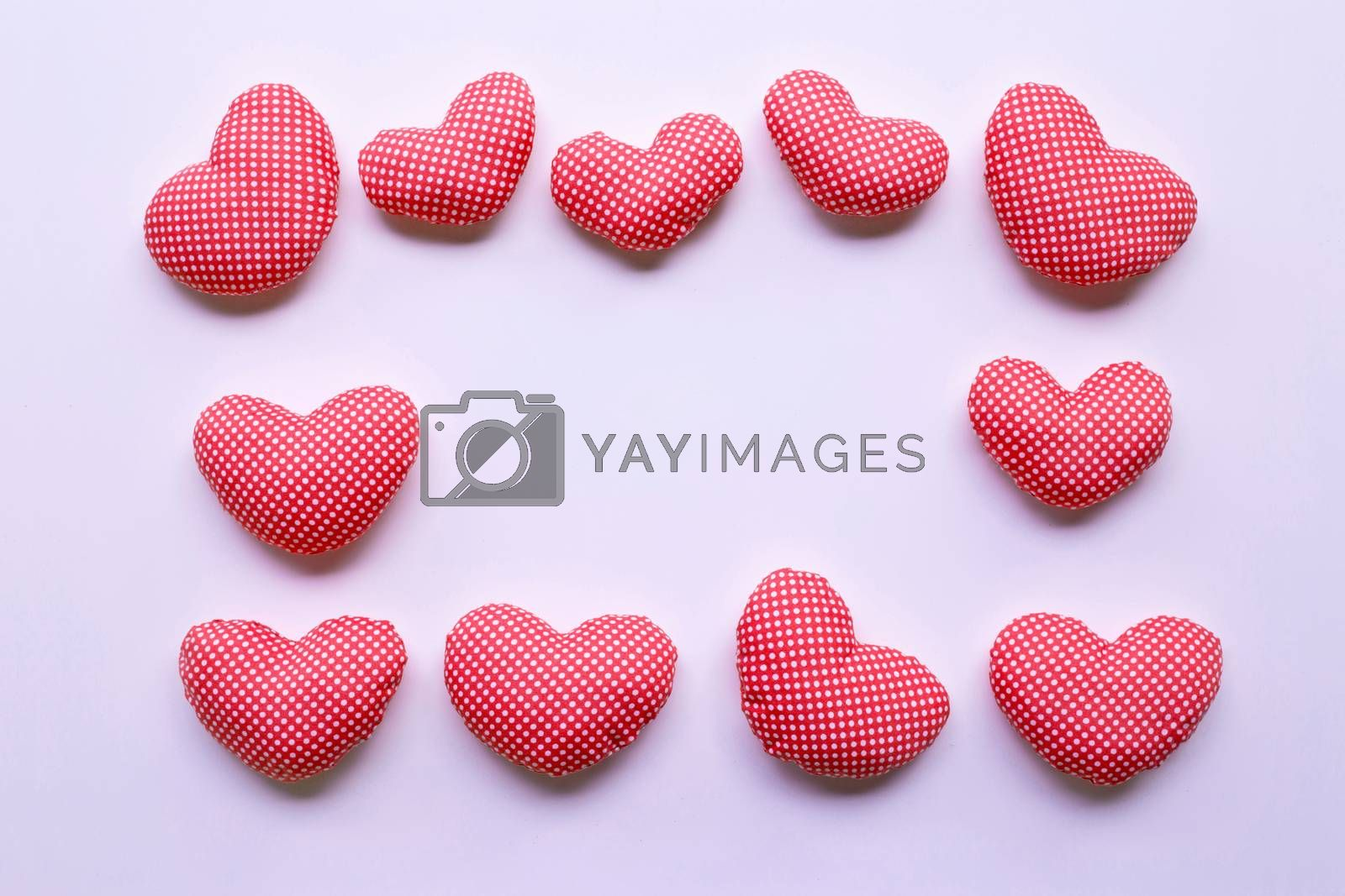 Frame of valentine's hearts on white background