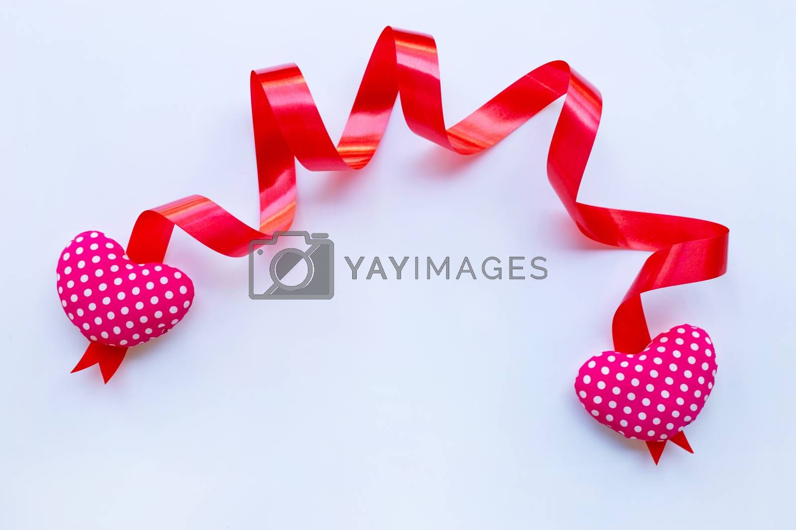 Valentine's hearts with ribbon on white background