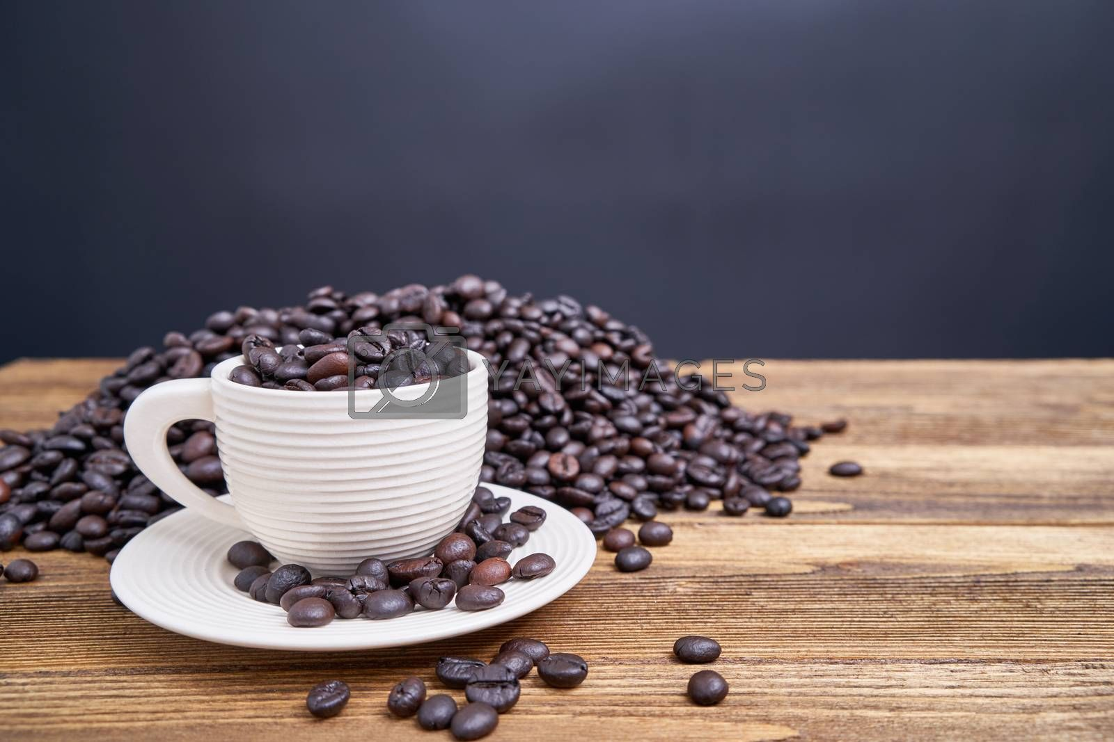Royalty free image of Close up coffee bean in white cup with copy space by eaglesky