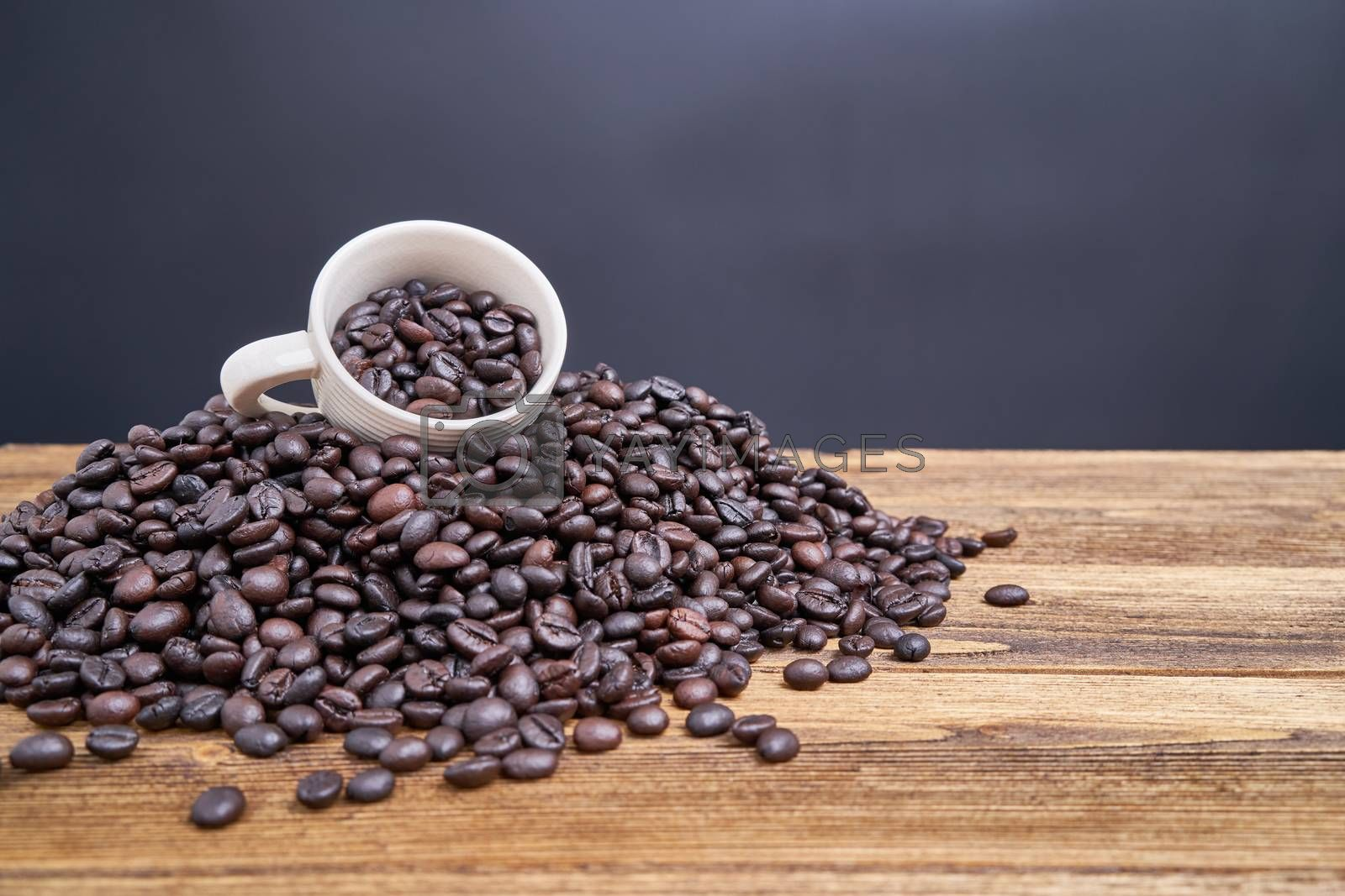 Royalty free image of Coffee bean in white cup place on pile coffee bean by eaglesky