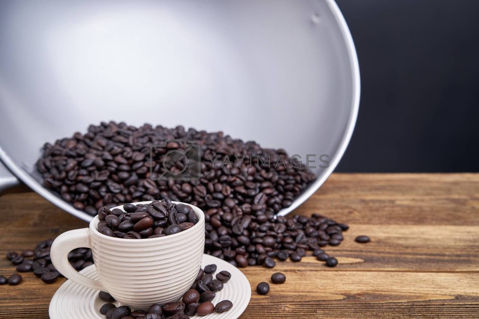 Royalty free image of Close up coffee bean in white cup with black background by eaglesky