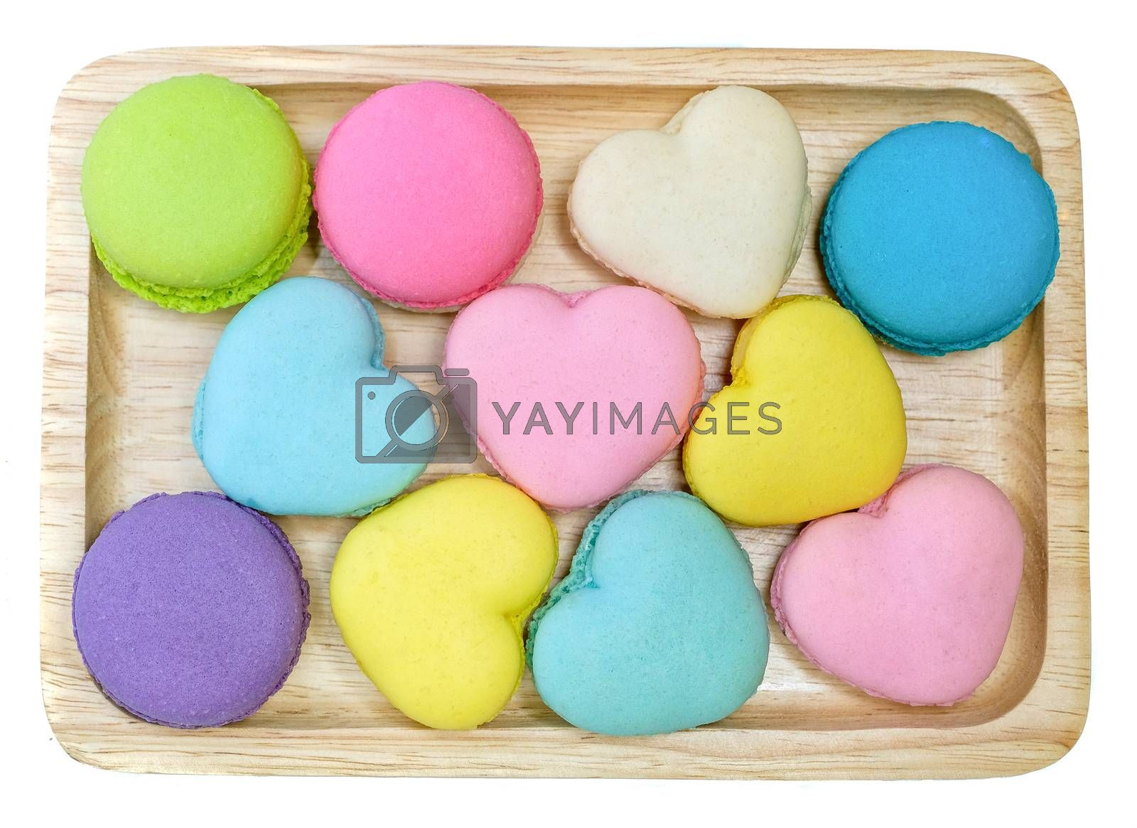 multi colored macaroons on a wooden trey by Nawoot