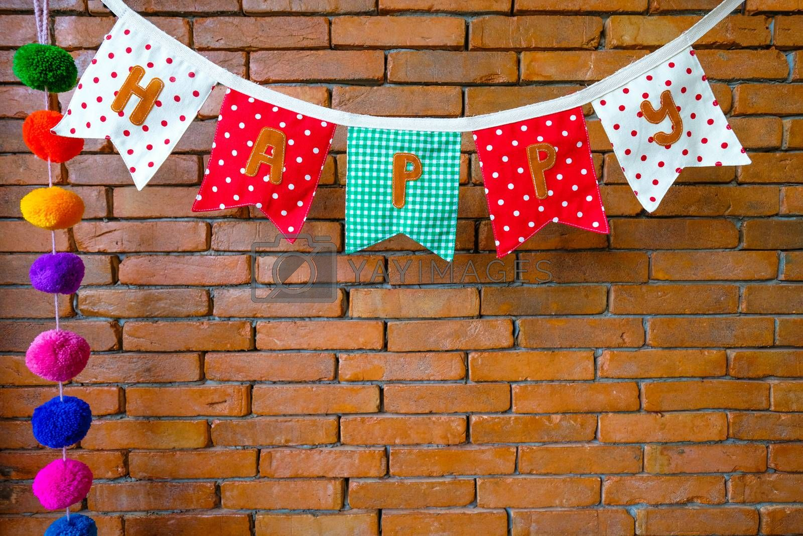 a cloth hanger on a brick wall by Nawoot