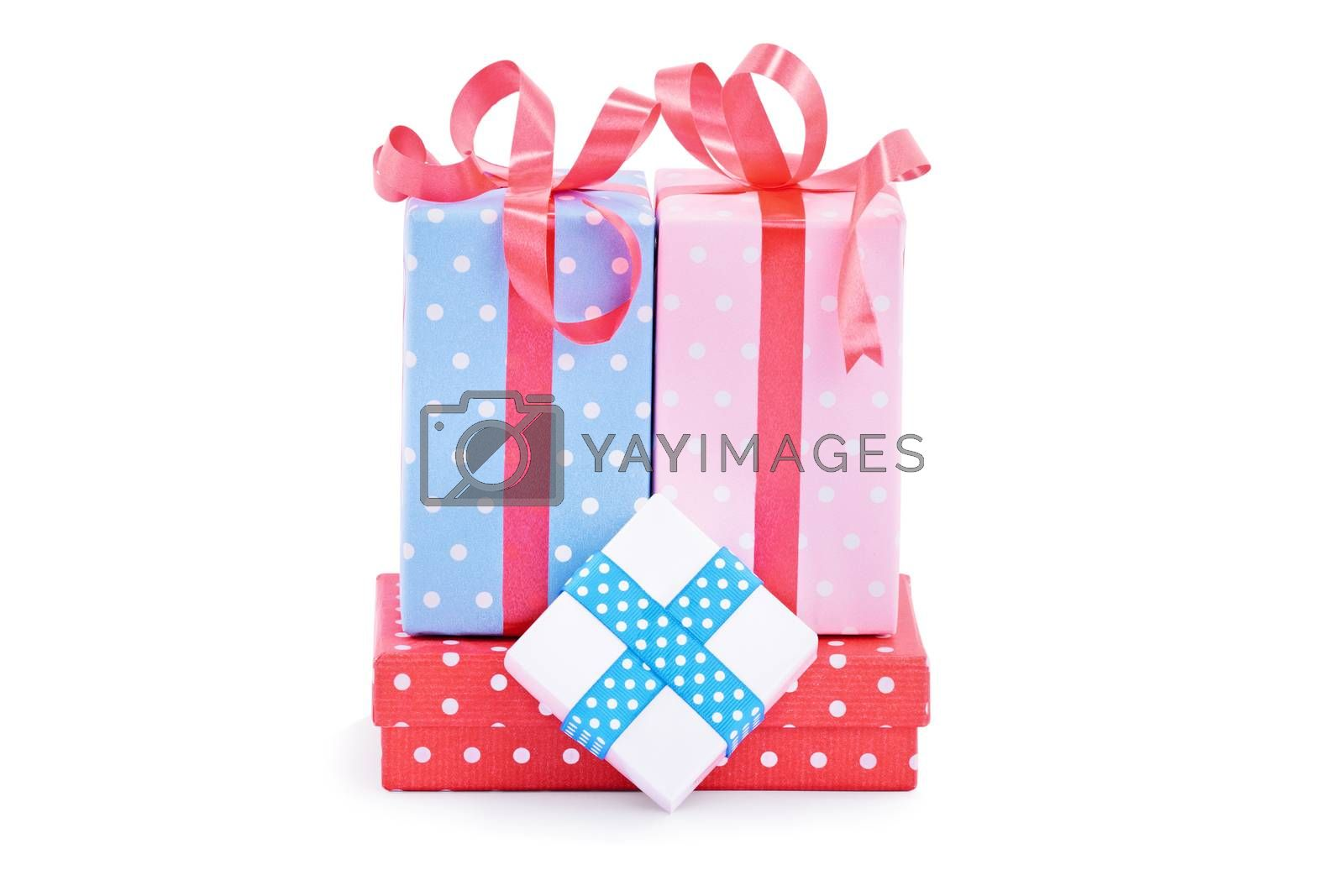 Pile of gifts, wrapped in cute wrapping paper and ribbons, isolated on white background. Christmas, New Year, anniversary, birthday, Valentine's Day concept.