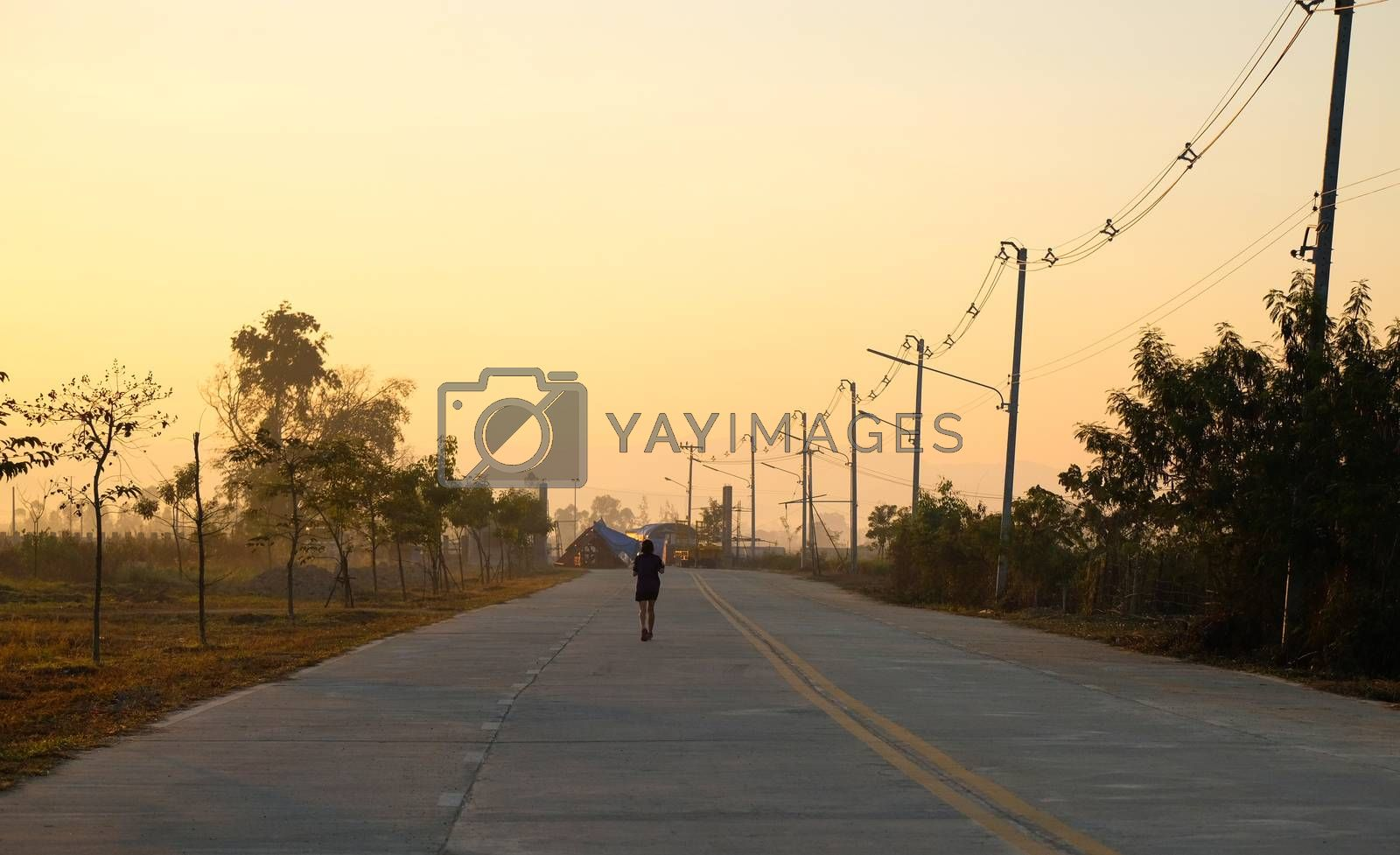 a runner  in an empty road by Nawoot