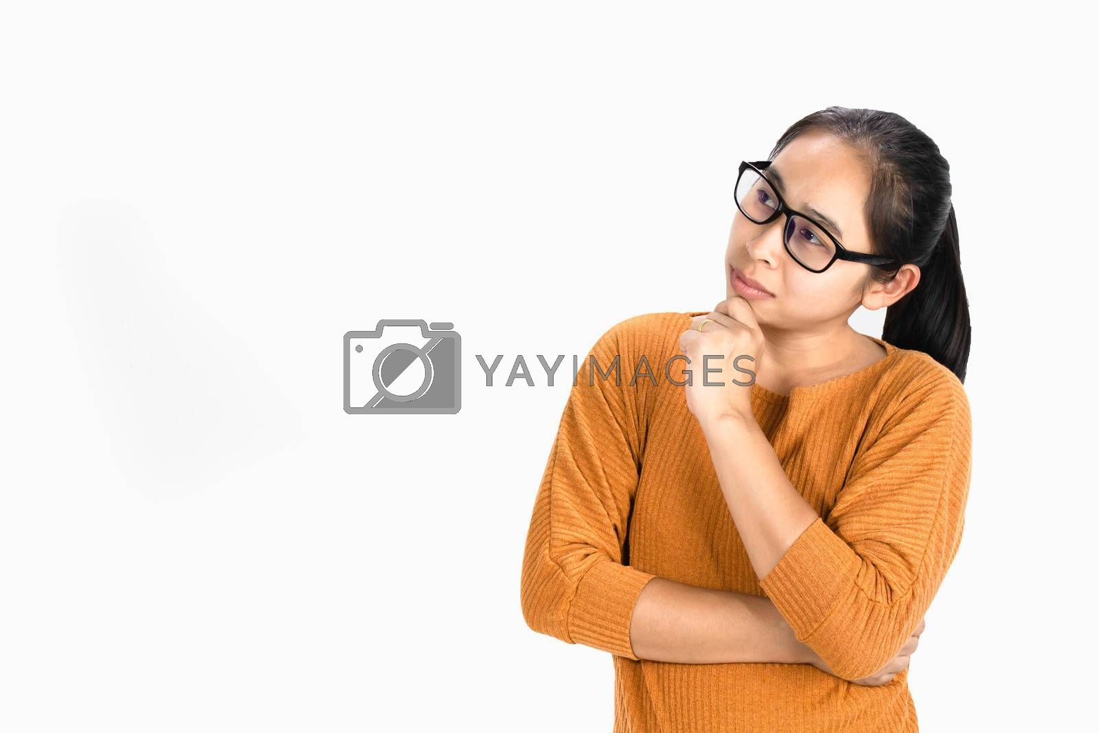 Close up portrait of Asian woman thoughtful girl, wearing glasses and holding hand near the face, looking seriously up, standing over white background with copy space. by TEERASAK
