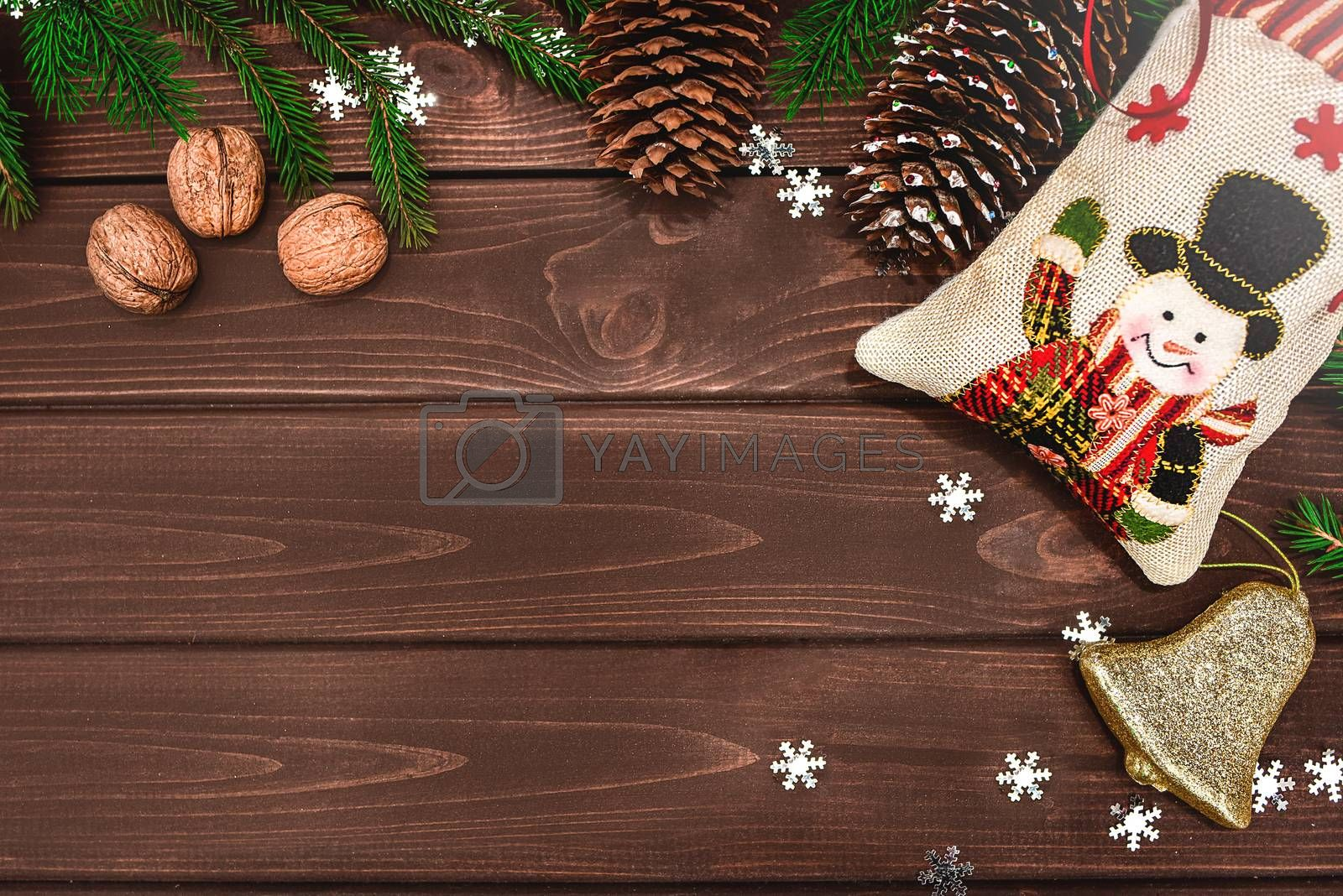 Christmas background Fir branches, cones and nuts on a wooden table. Space for text . View from above. Christmas atmosphere