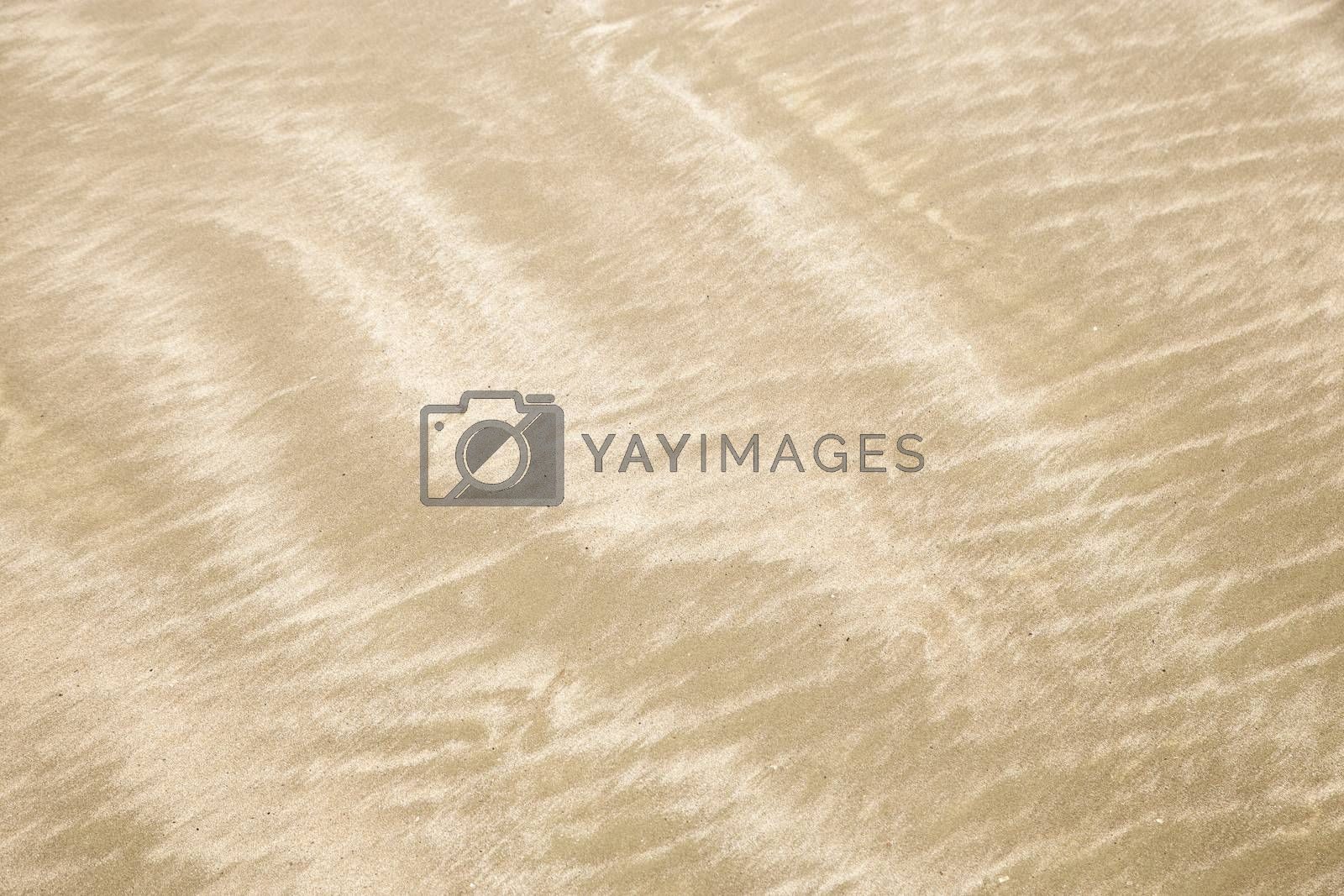 Abstract background of sand pattern on the beach