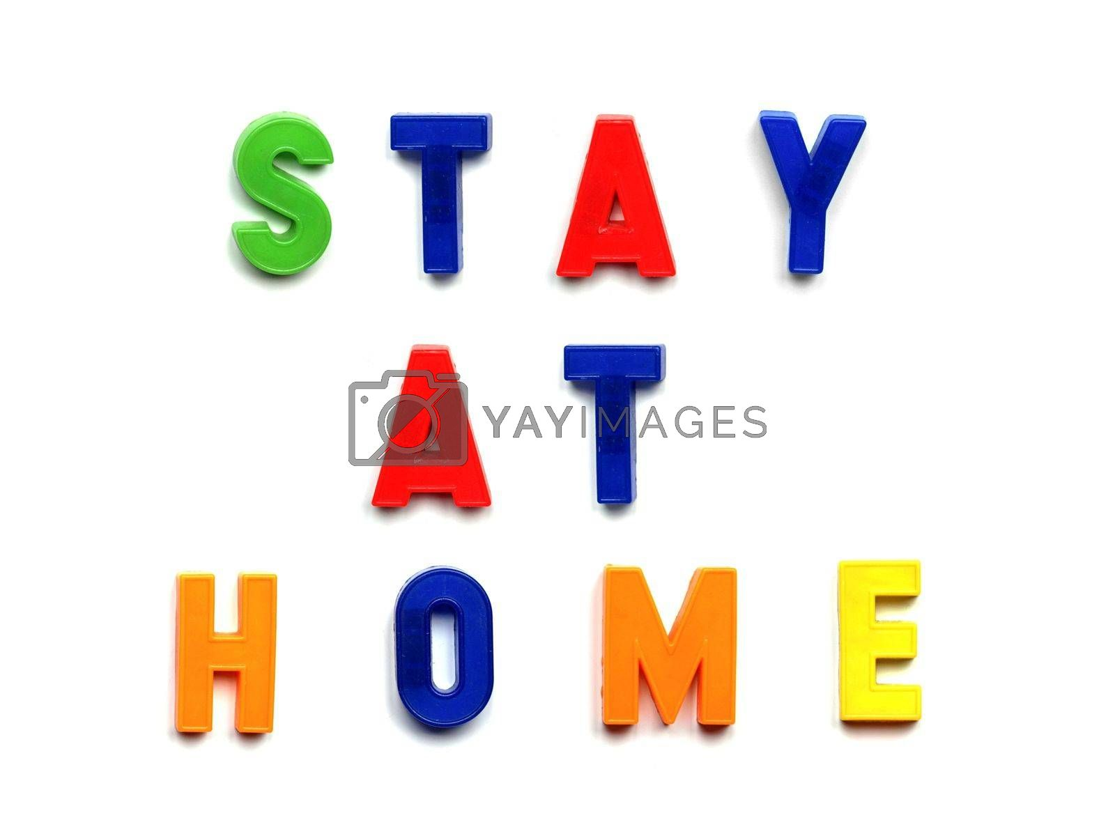 Stay at home sign written with toy magnetic letters