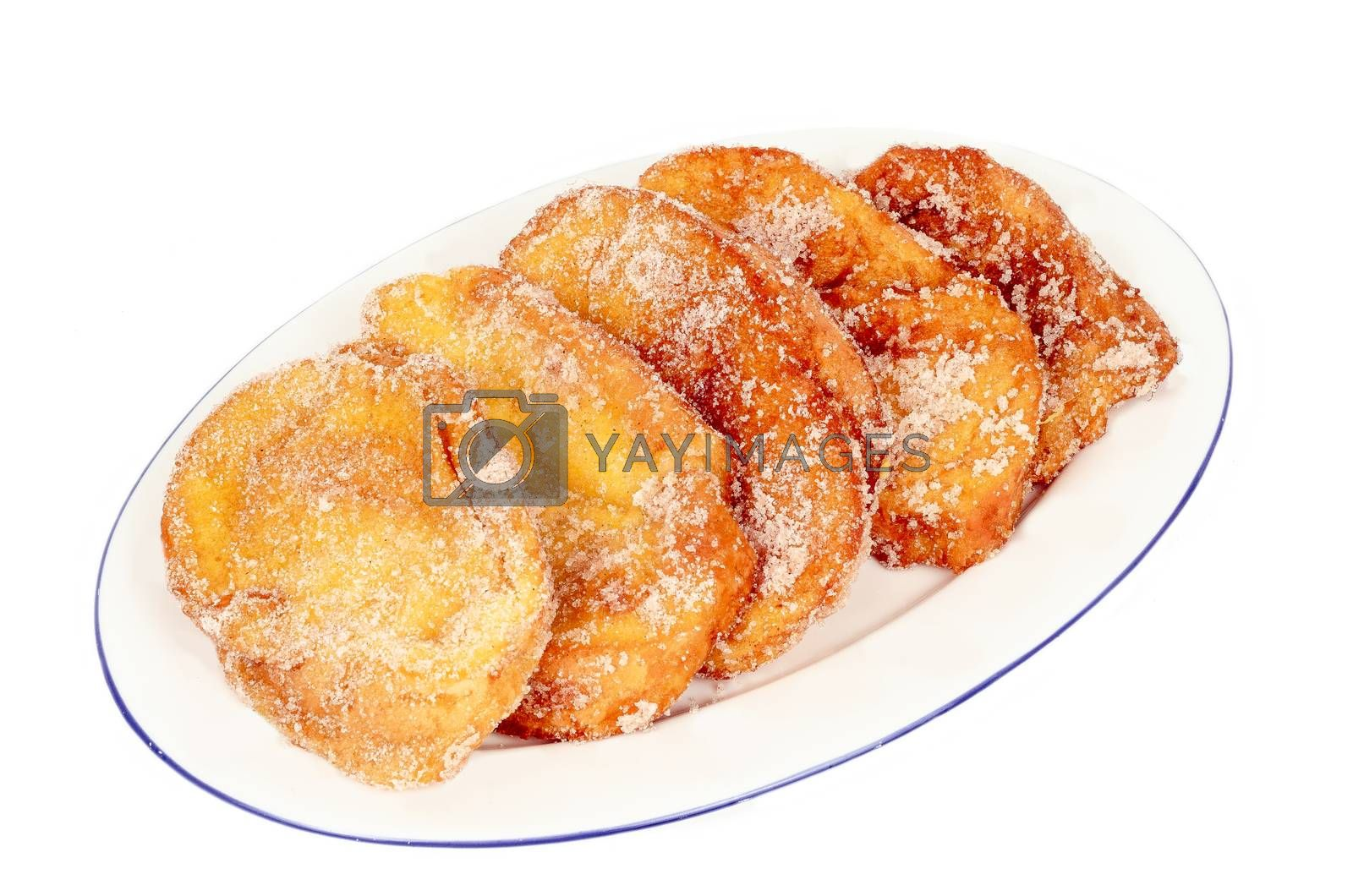 closeup of a plate with torrijas isolated on white background. Typical spanish dessert for Lent and Easter.