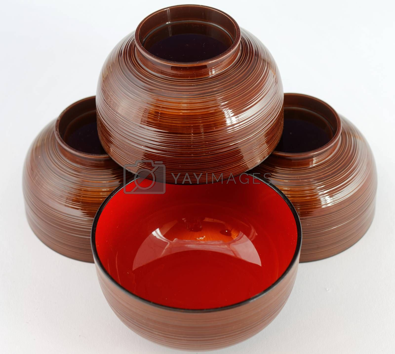 Still life of four Japanese lacquer bowls for miso soup or noodle soup, isolated