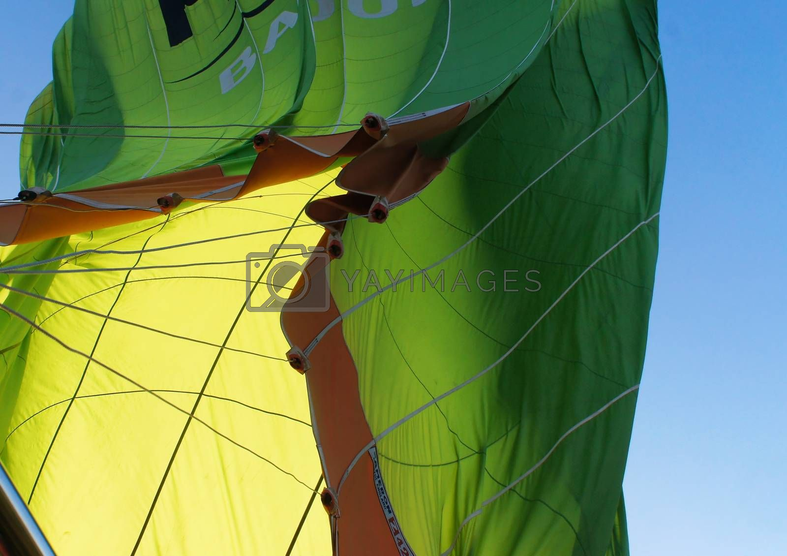 View from below onto the collapsing envelope of a green hot-air balloon, Cappadocia, Anatolia, Turkey