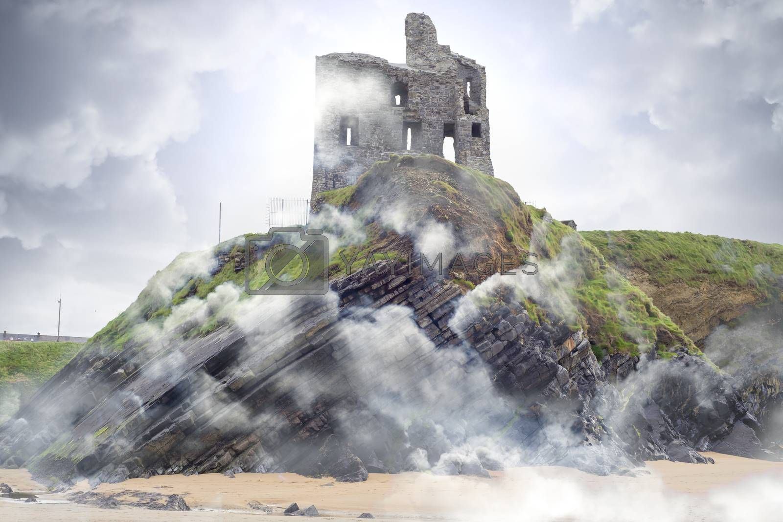 Ballybunion castle ruins on cliff top in foggy mist