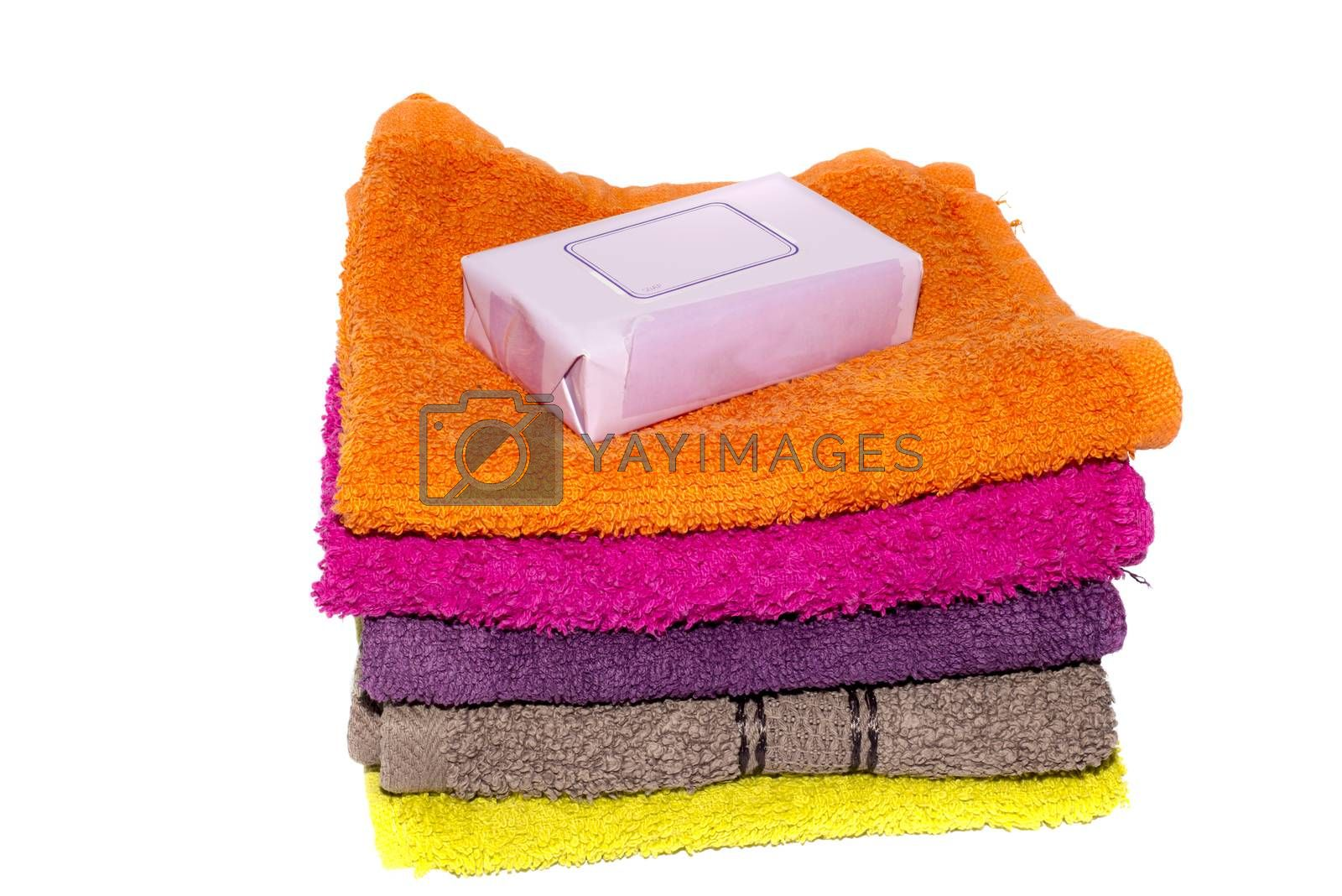 soap on top of facecloths of various shades