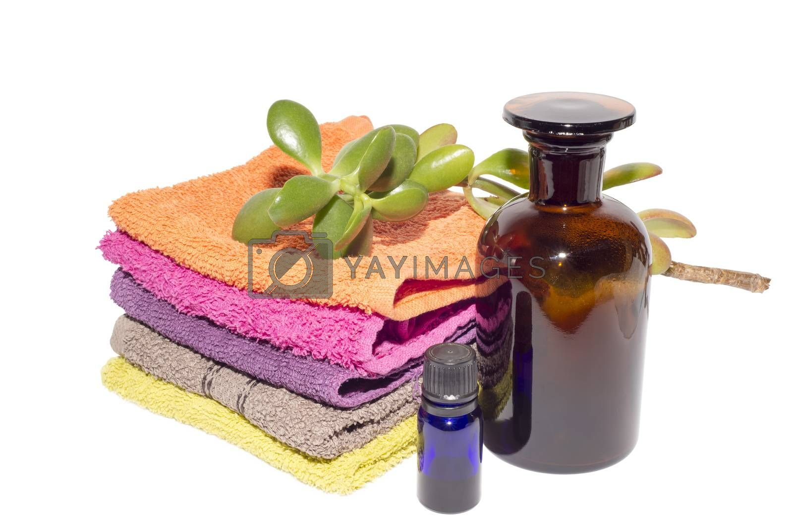 soap on top of facecloths of various shades with bottles