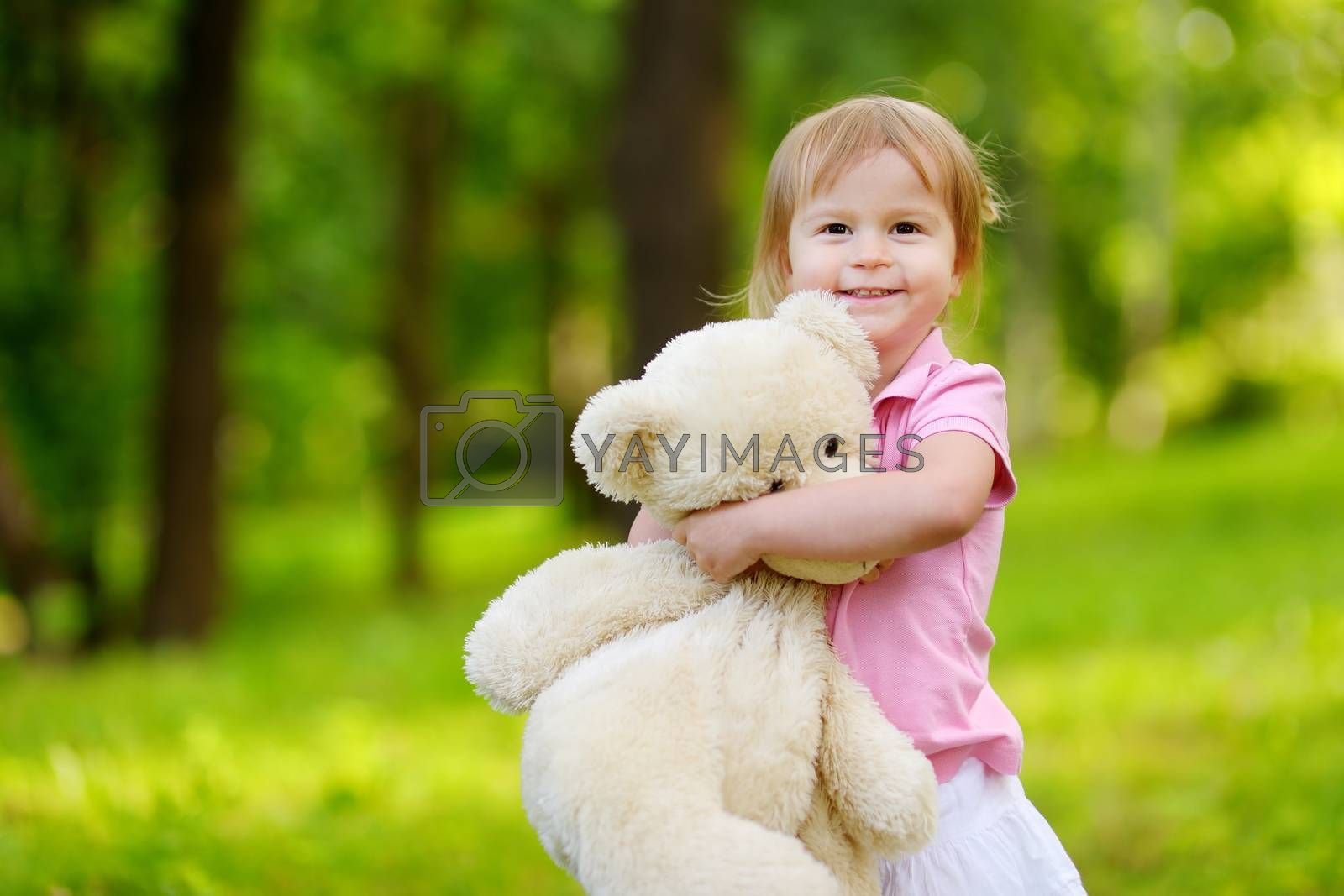 Adorable little toddler girl with a big teddy bear by maximkabb