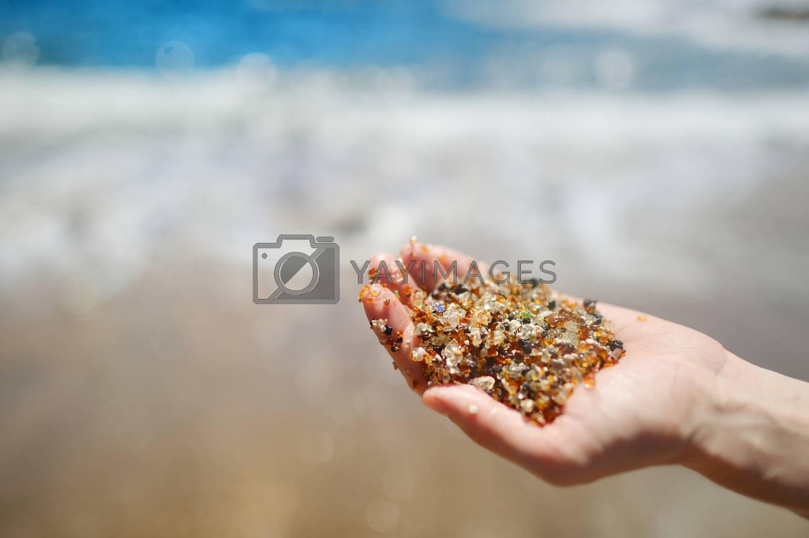 Stunning sand of glass beach near Port Allen town on Kauai, Hawaii