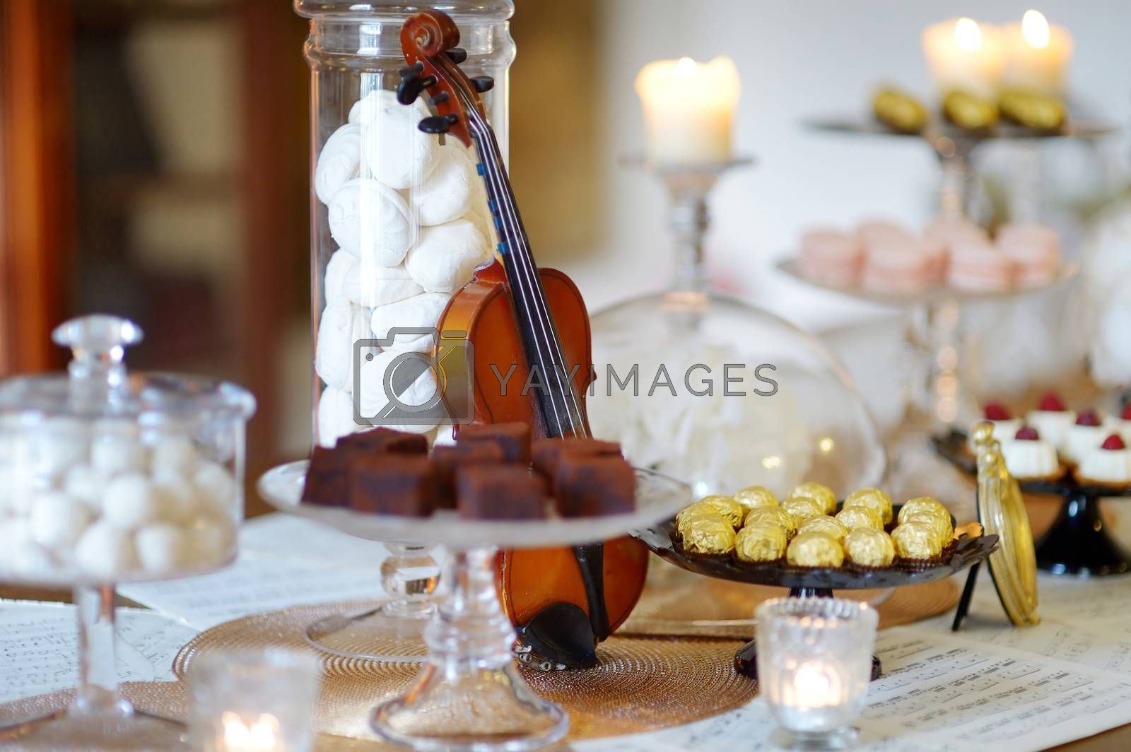 Royalty free image of Beautiful desserts, sweets and candy table by maximkabb