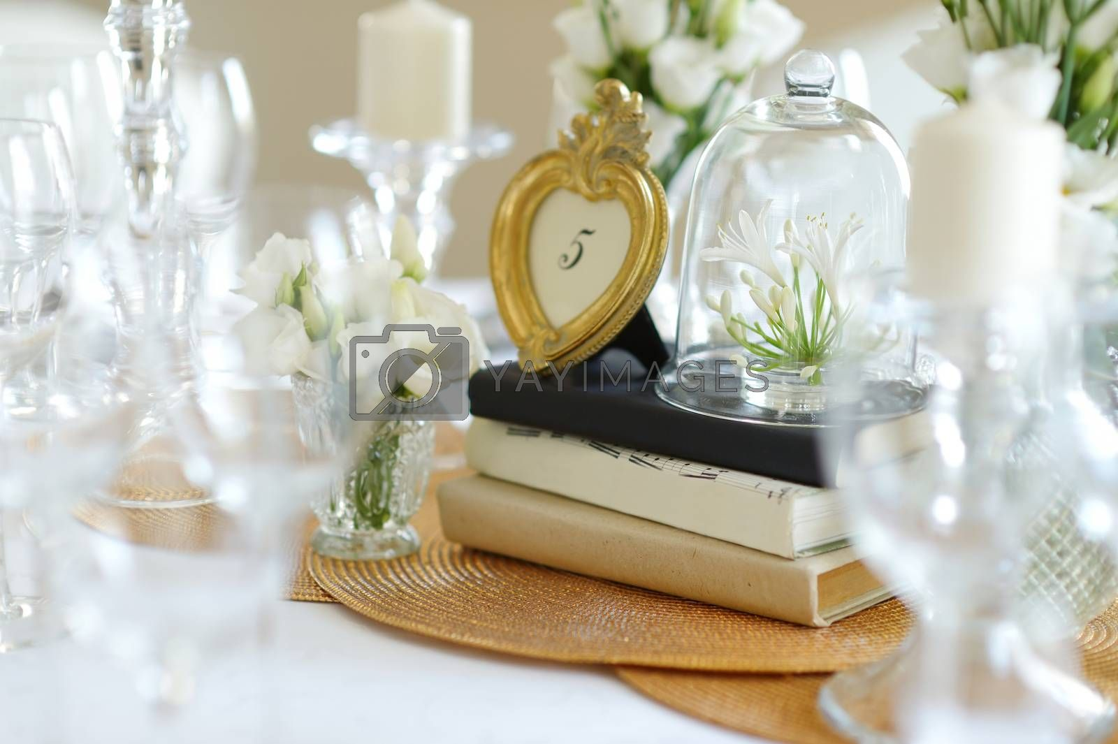 Royalty free image of Table set for an event party or wedding reception by maximkabb