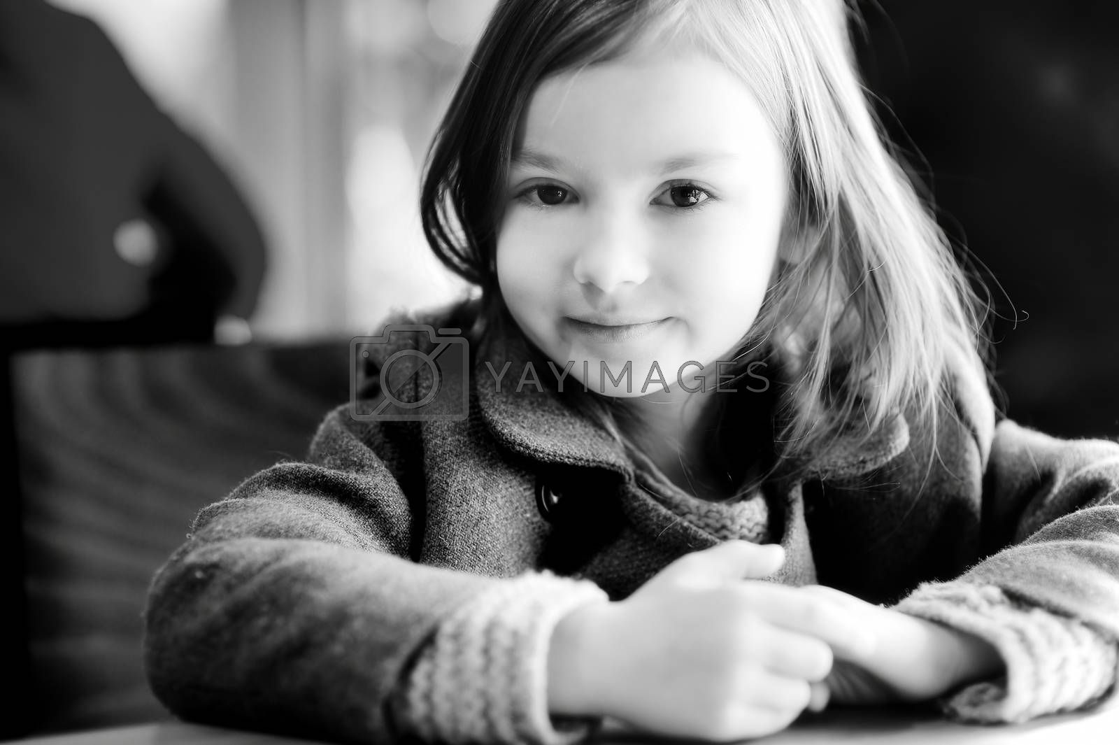 Black and white portrait of a beautiful little girl outdoors