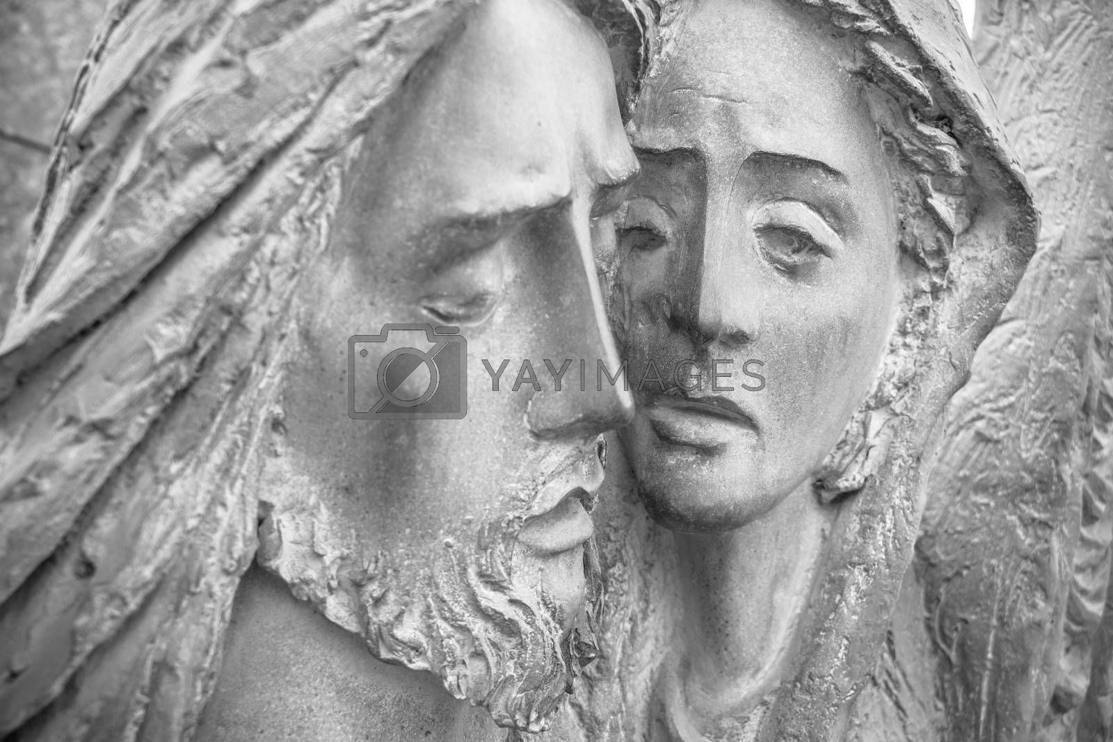 Bas-relief in bronze representing The Pity of Michelangelo. Faces of Holy Mary mother and Jesus Christ after the Crucifixion.