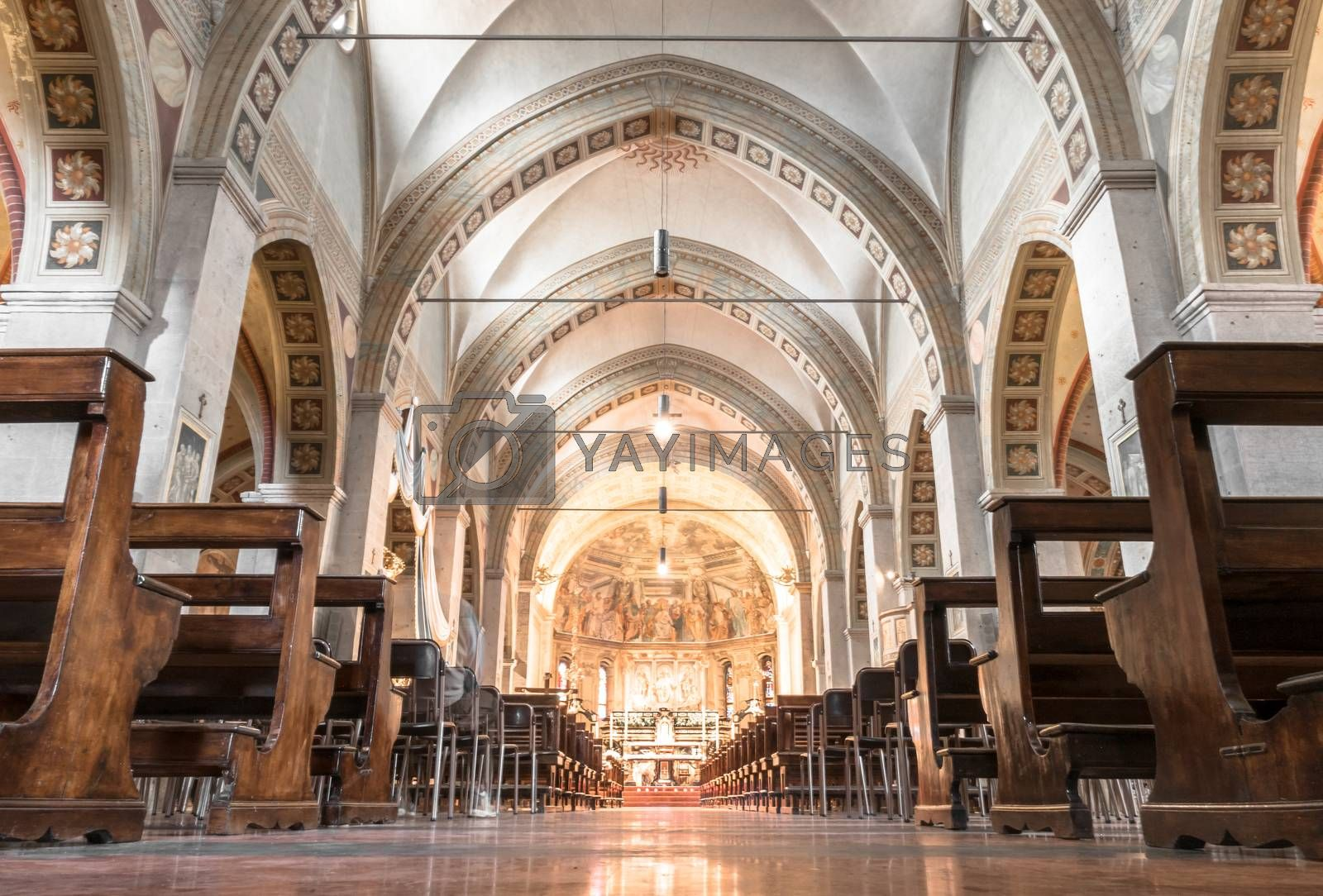 Inside a church in italy. Symbol of Christianity and Catholicism. Ideal for concepts or festivity. Bottom view.