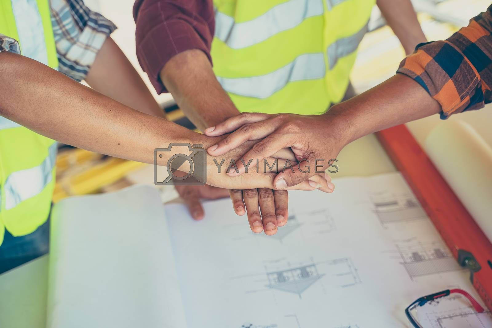 Engineers and architect join hands to build successful projects.Teamwork concept.