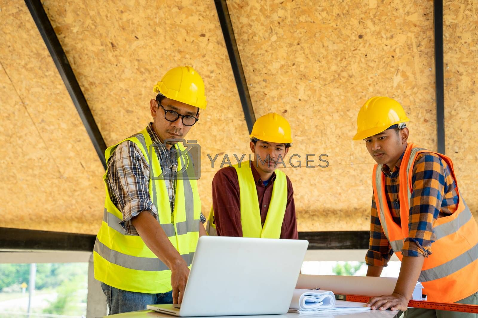 Industrial engineering team meeting and working at construction site.