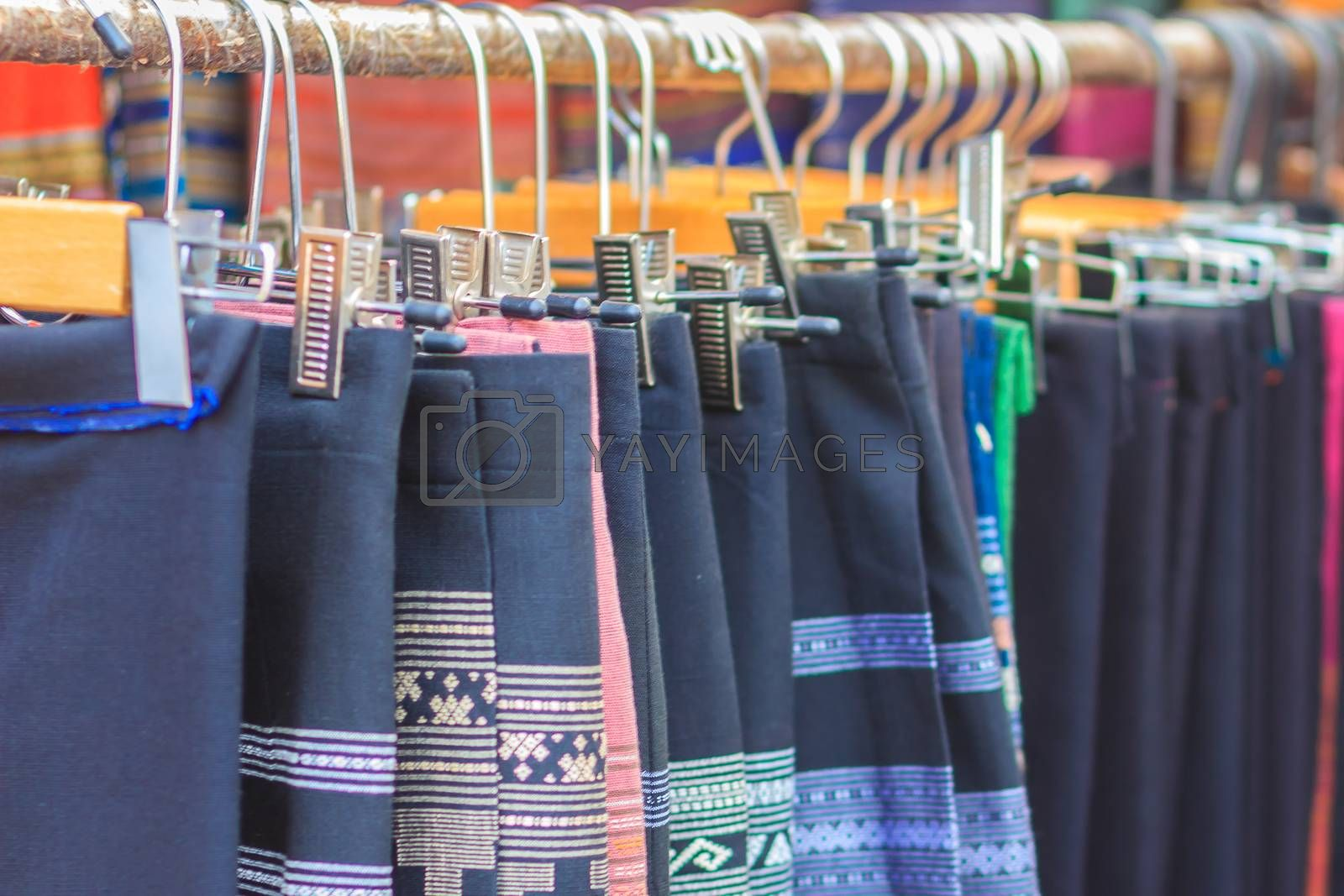 Beautiful Thai tribal clothes and tribal textile style in the northern of thailand. Beautiful handmade tribal cloth ethnic patterns for sale in the local market.