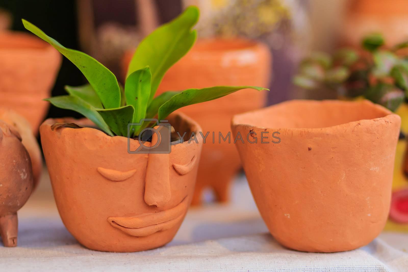 Beautiful handmade ceramic pot and vase in exotic patterns at night market.