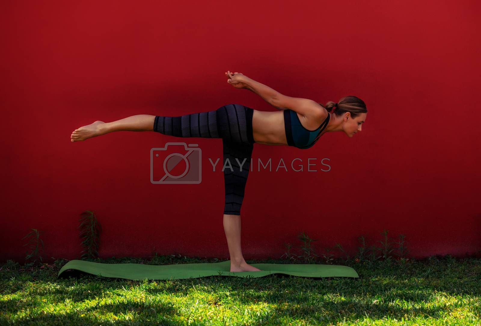 Beautiful Young Woman Doing Yoga Outdoors. Virabhadrasana. Warrior 3. One-Legged Pose. Enjoying Healthy Life and Sport.