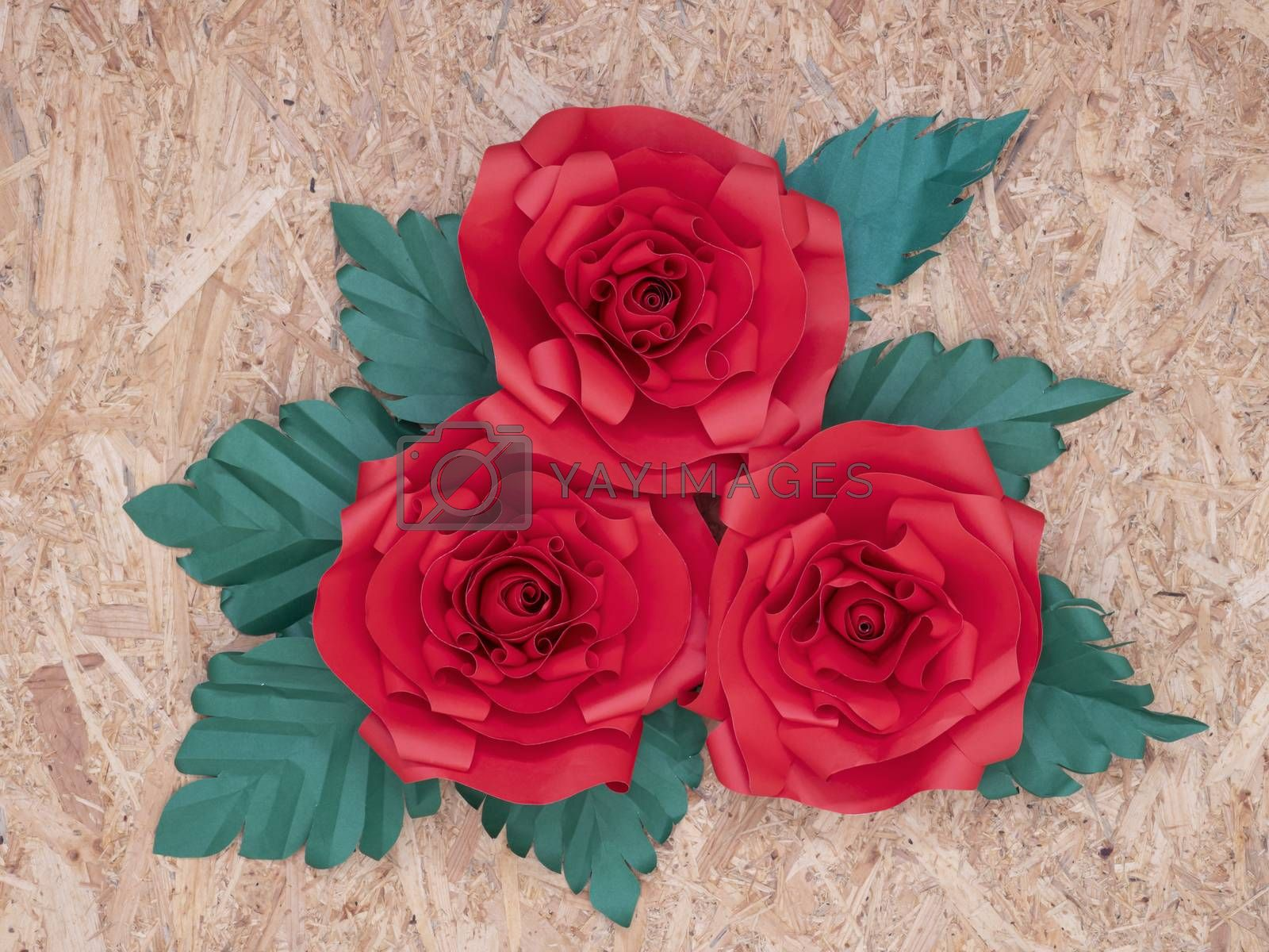 Red paper roses with green leaves by Nawoot