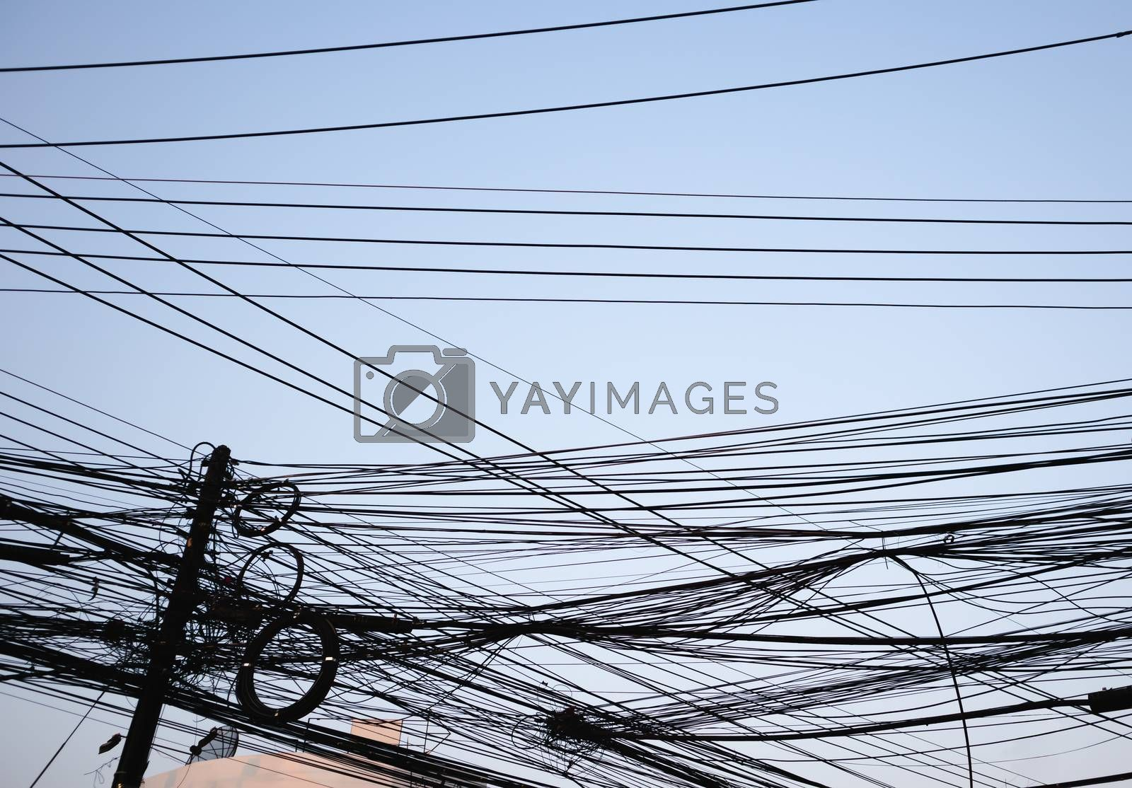 Messy electrical wires city background on clear sky