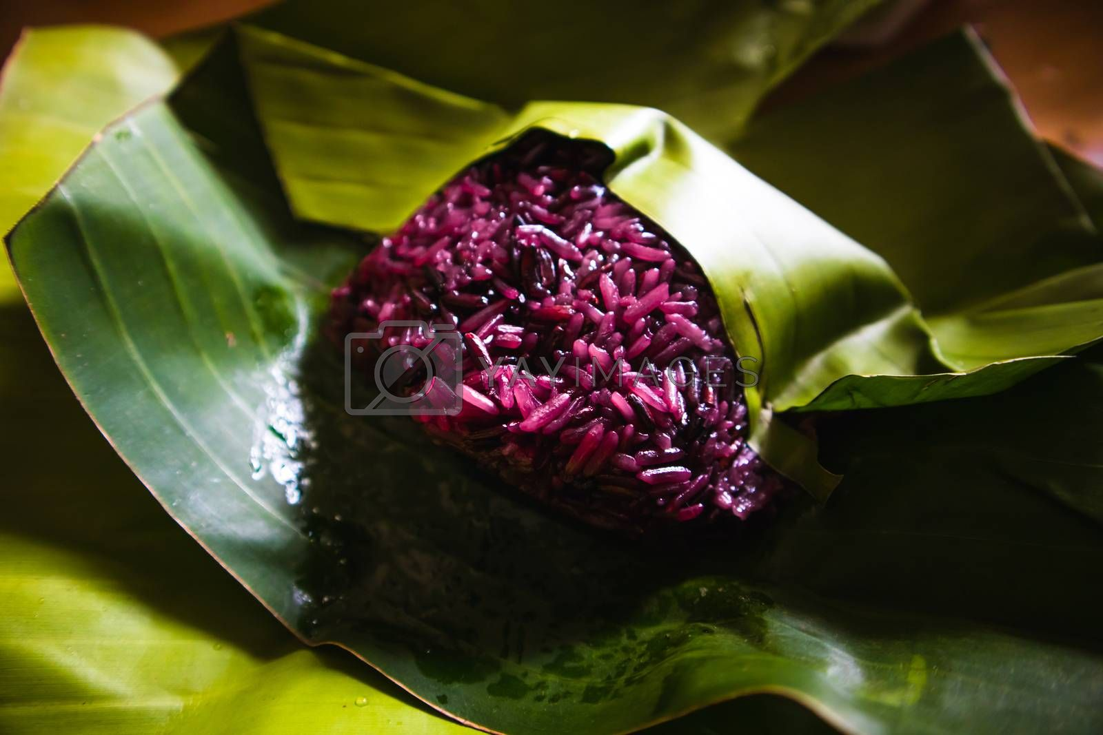 Purple sticky rice on banana leaf package. Organic food background concept.